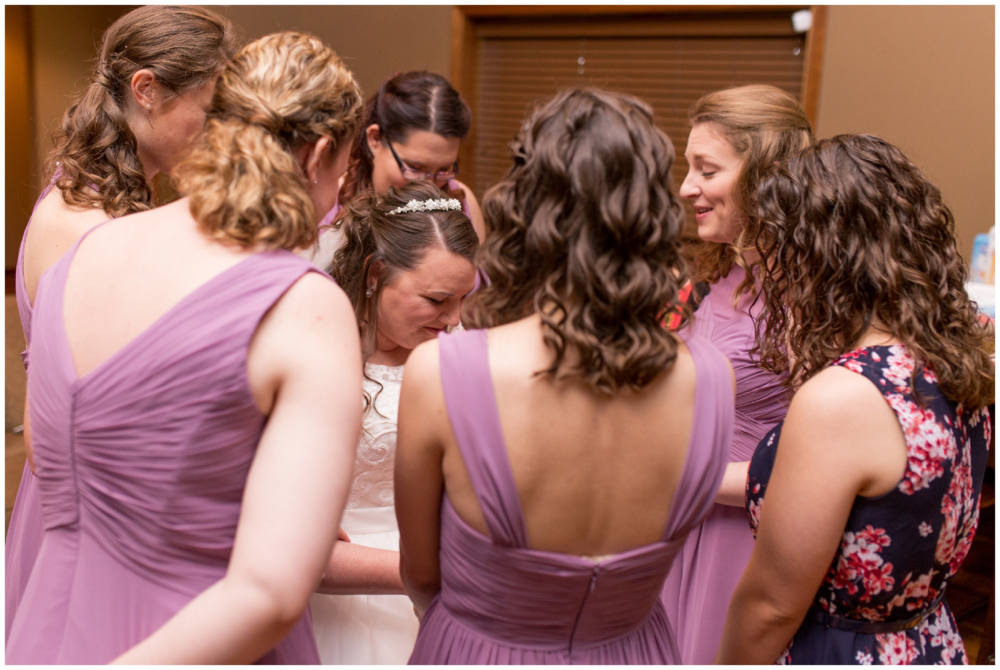 bridesmaids pray over bride before wedding ceremony at Crossroads Community Church in Kokomo Indiana