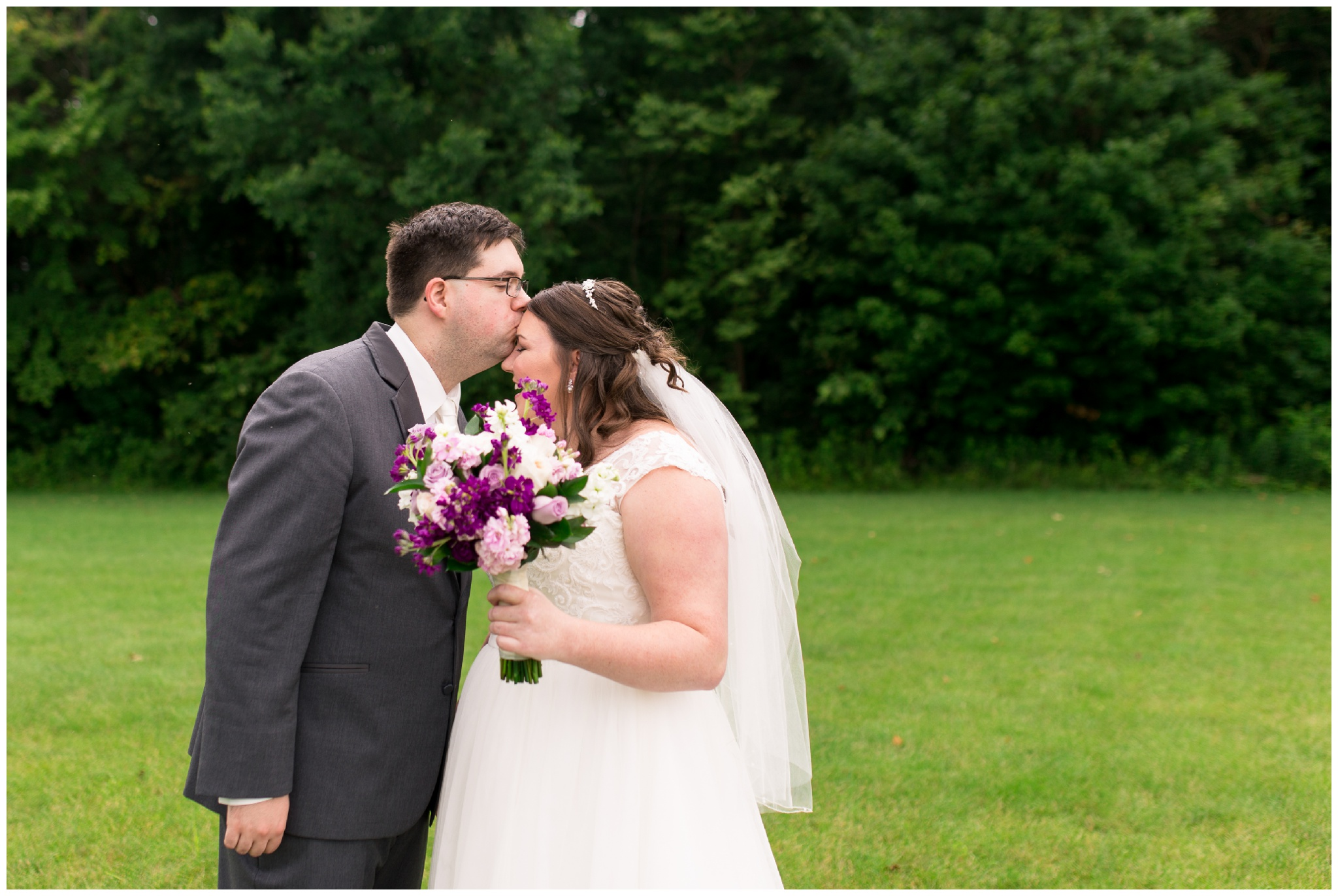 groom kisses bride's forehead before wedding at Crossroads Community Church in Kokomo Indiana