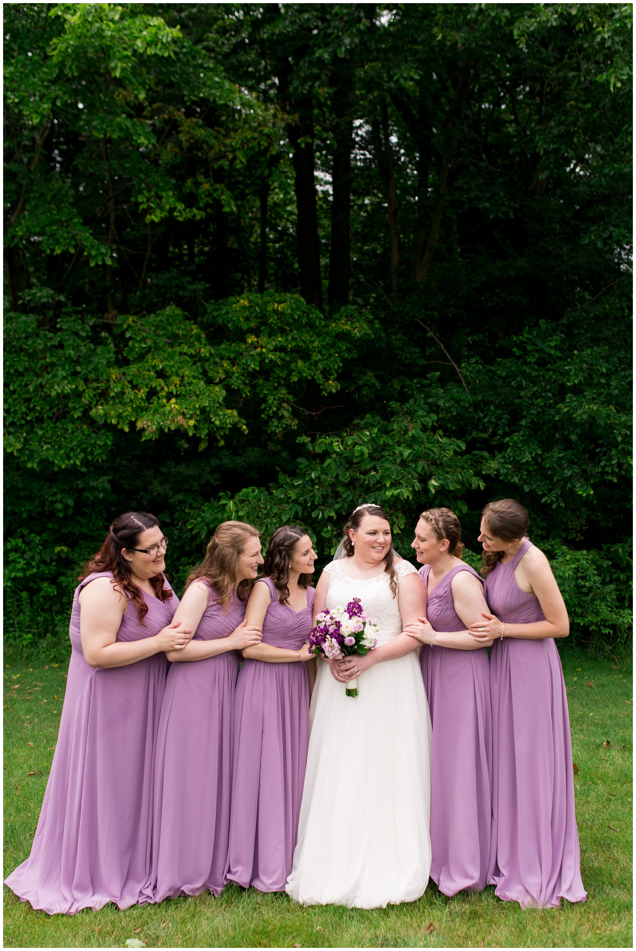 bridesmaids look at the bride before wedding at Crossroads Community Church in Kokomo Indiana