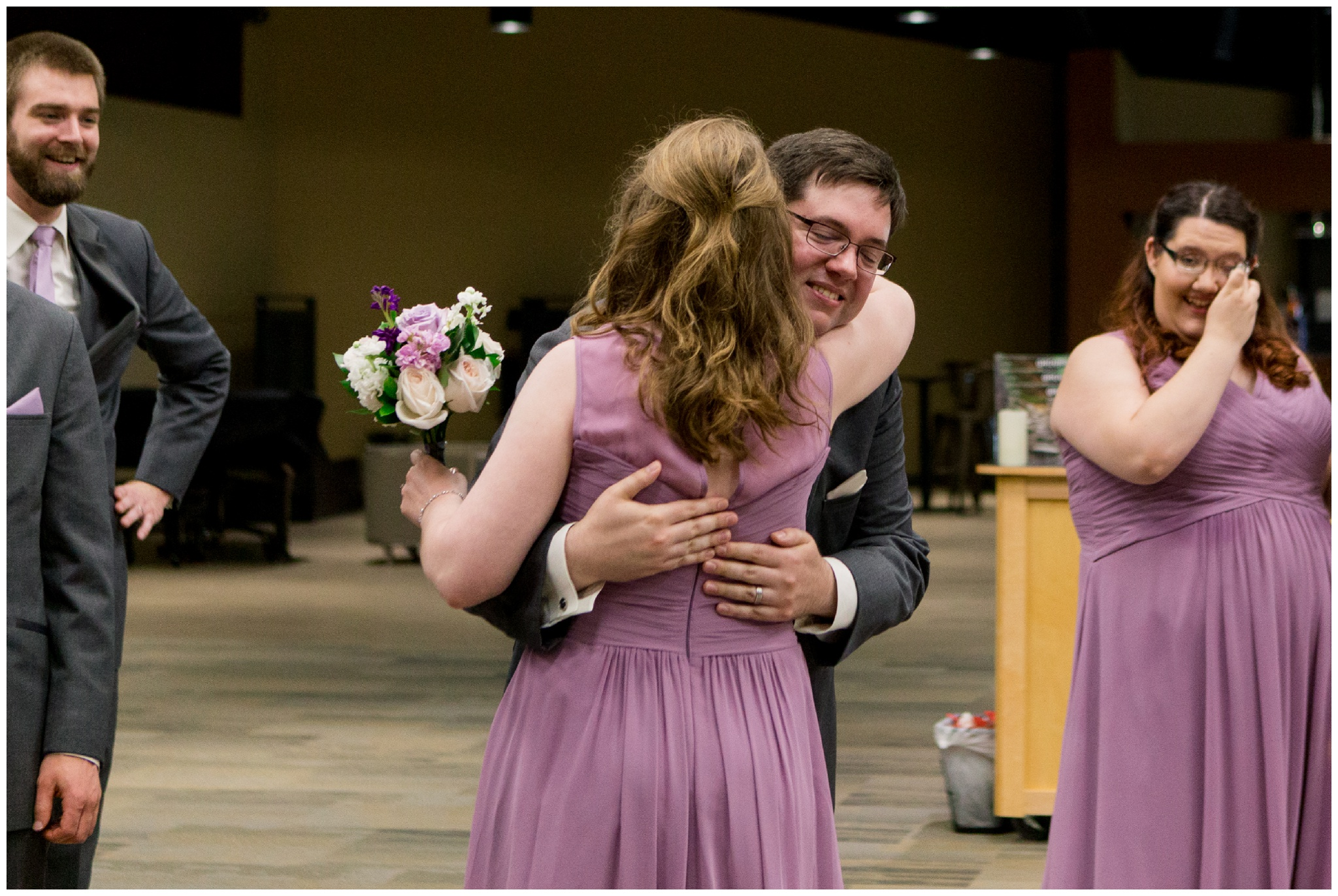groom hugging sister in law after wedding ceremony at Crossroads Community Church in Kokomo Indiana