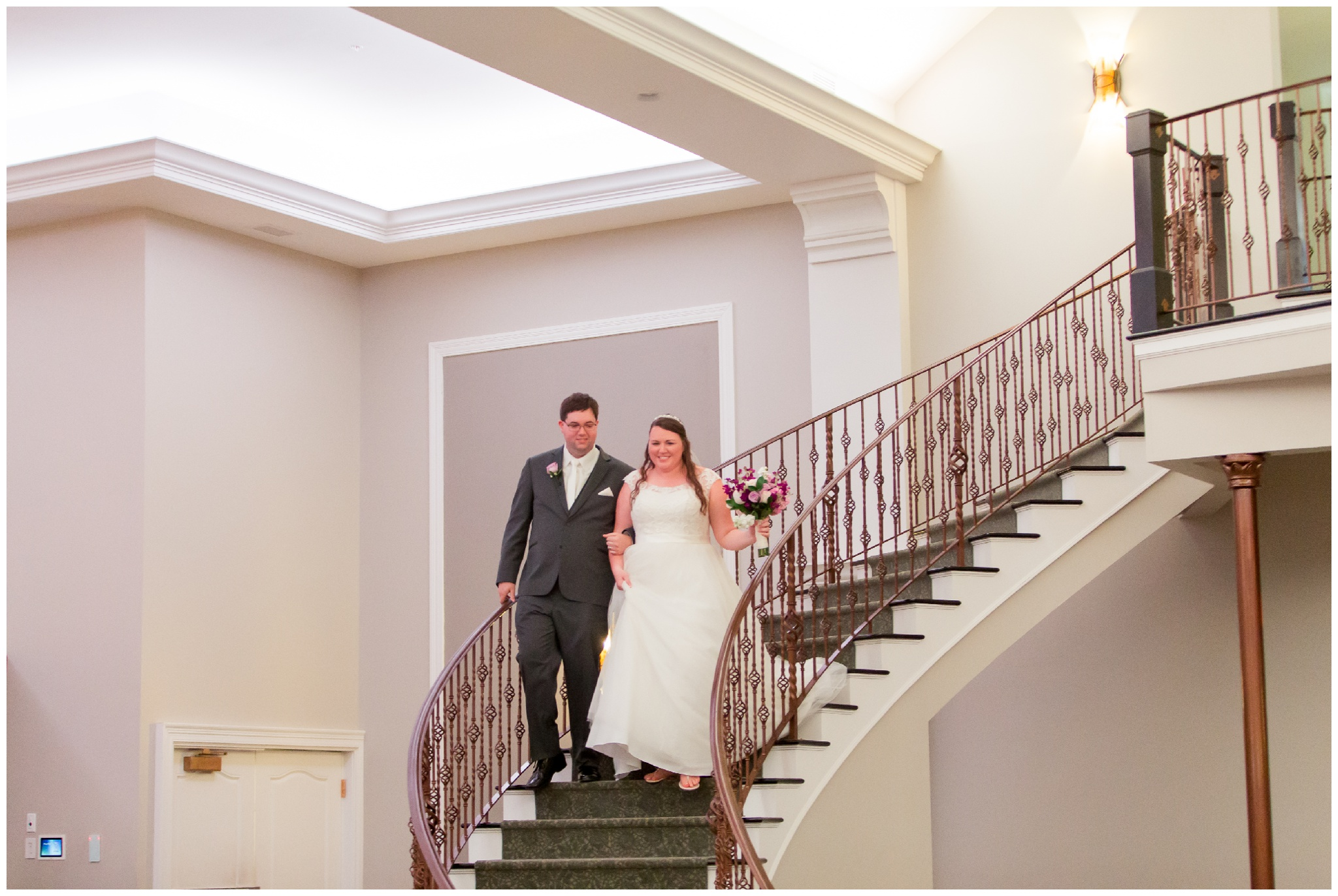 bride and groom on stairs at Bel Air Events in Kokomo Indiana
