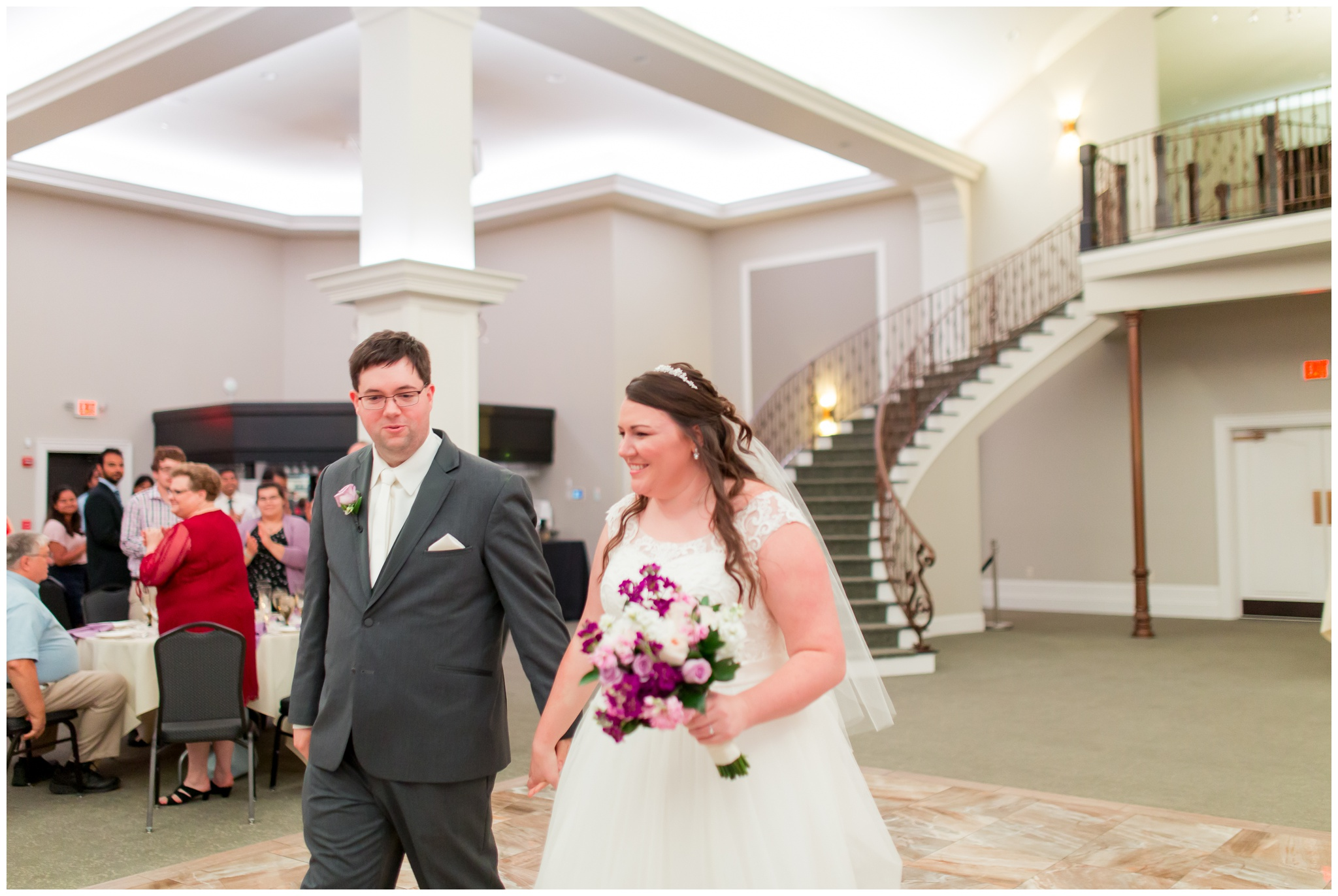 bride and groom walking into reception at Bel Air Events in Kokomo Indiana