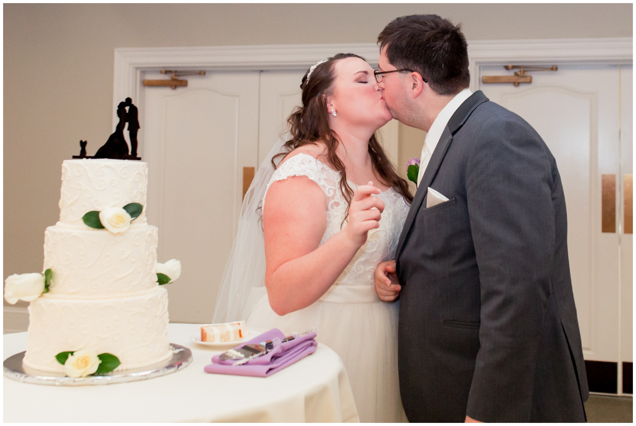 bride and groom kiss after cake cutting at Bel Air Events in Kokomo Indiana