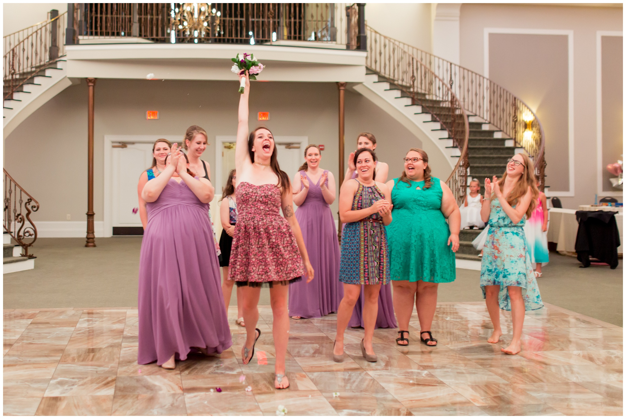 guest catches bouquet toss during wedding reception at Bel Air Events in Kokomo Indiana