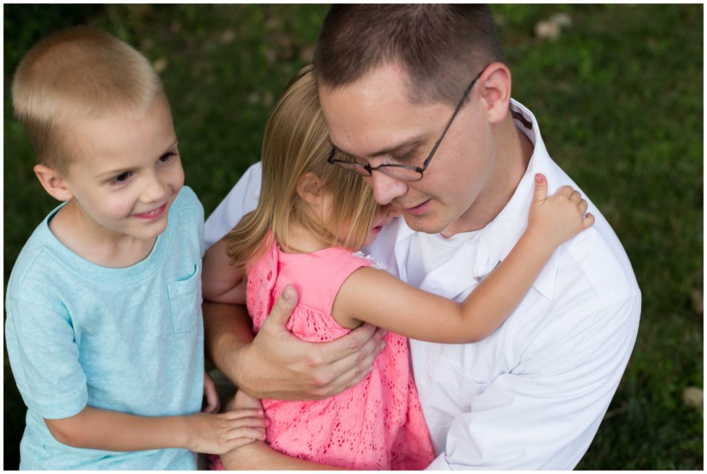 Father hugging daughter during Indianapolis backyard family portrait session