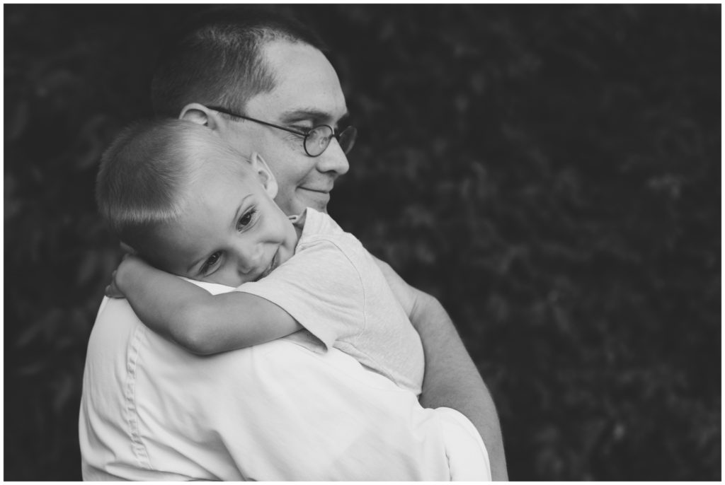 Son hugging father during Indianapolis backyard family portrait session