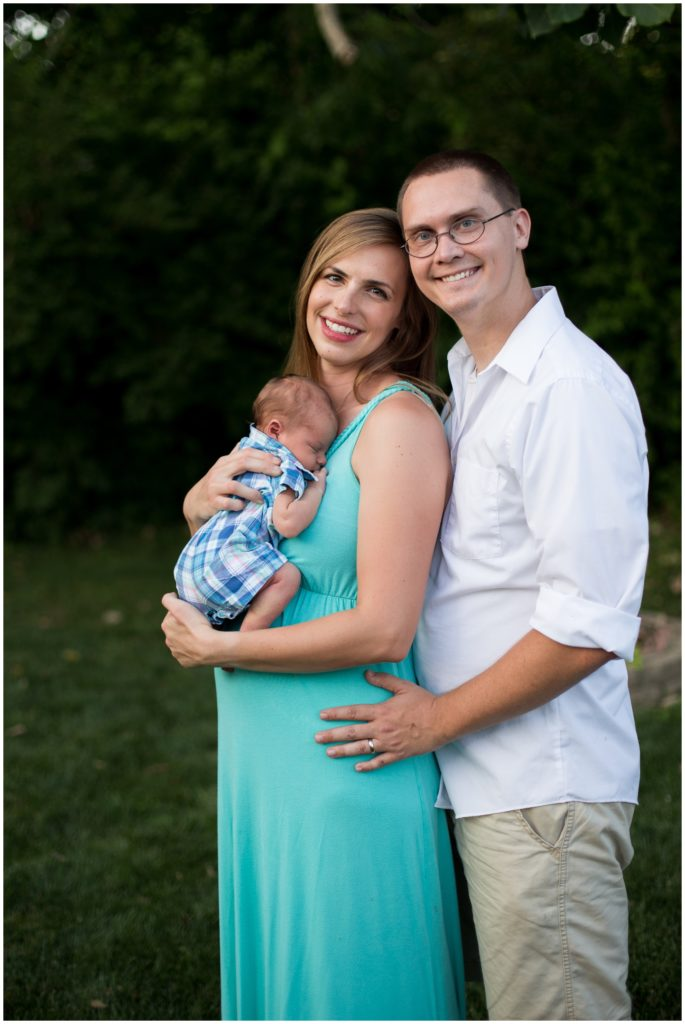 Mother and father pose with newborn during Indianapolis backyard family portrait session
