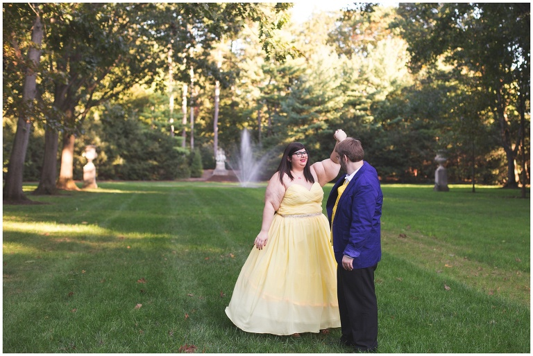 couple dances during engagement session at Indianapolis Museum of Art