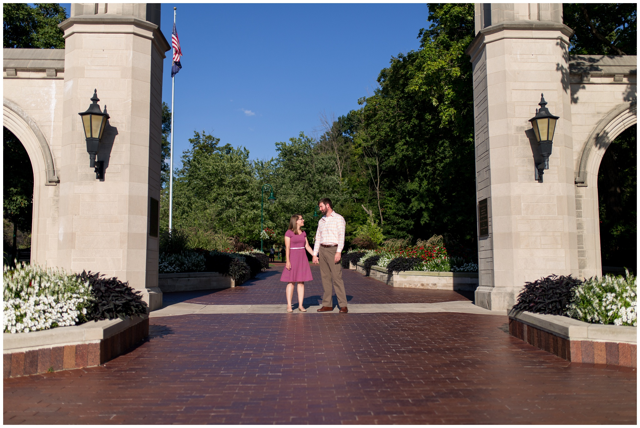 Engagement photo in front of Sample Gates on campus at Indiana University