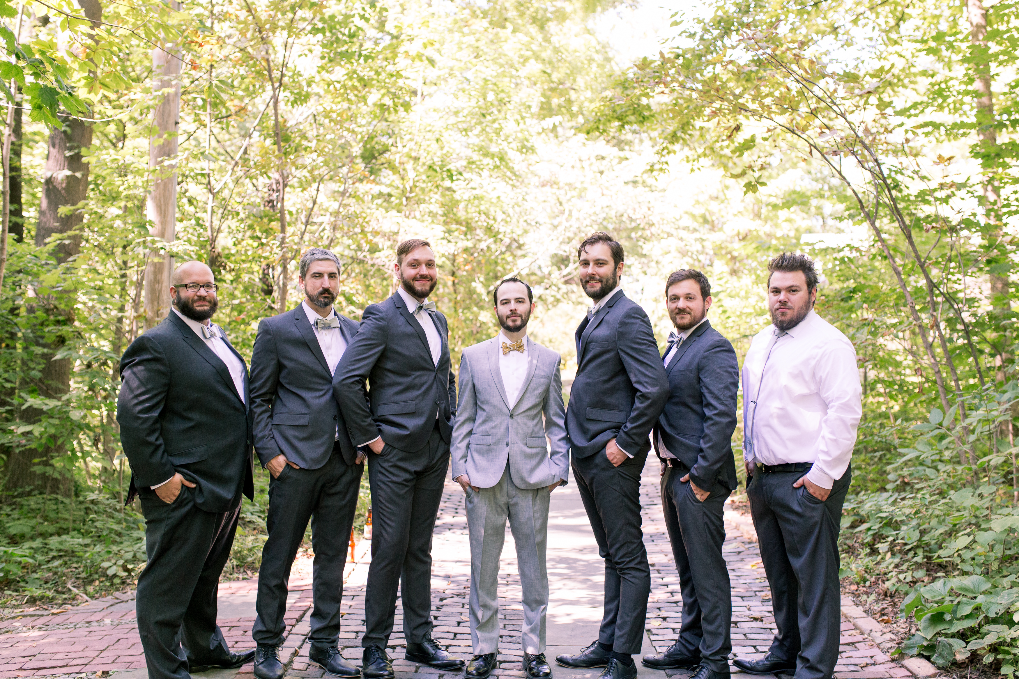 groomsmen and groom portraits before wedding at Minnetrista Cultural Center in Muncie Indiana