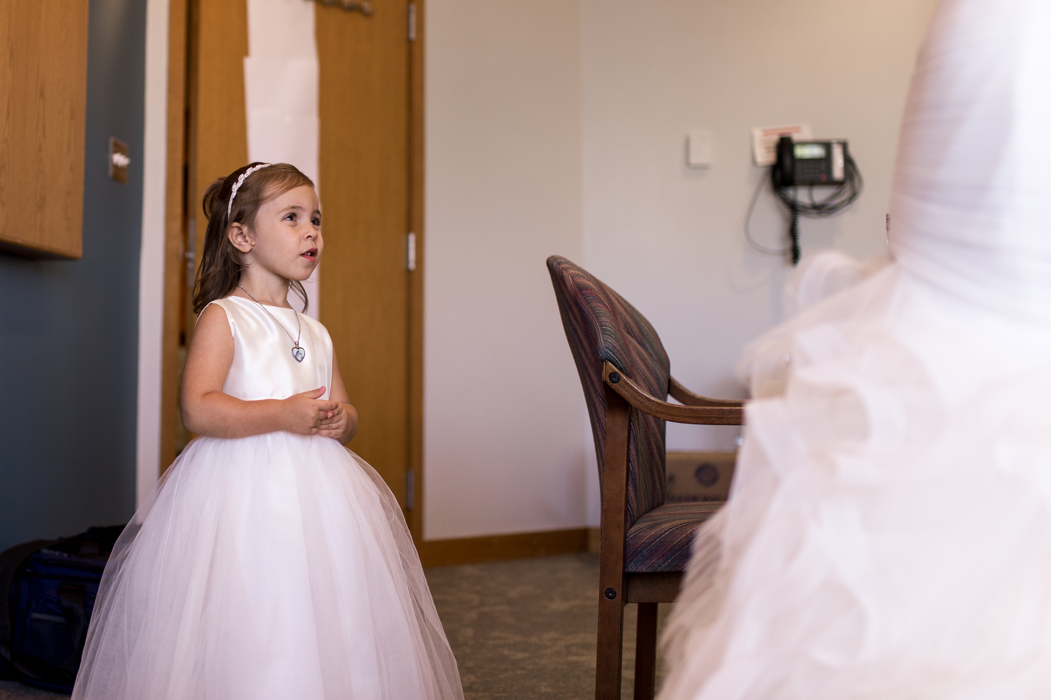 flower girl admiring bride on wedding day at Minnetrista in Muncie Indiana