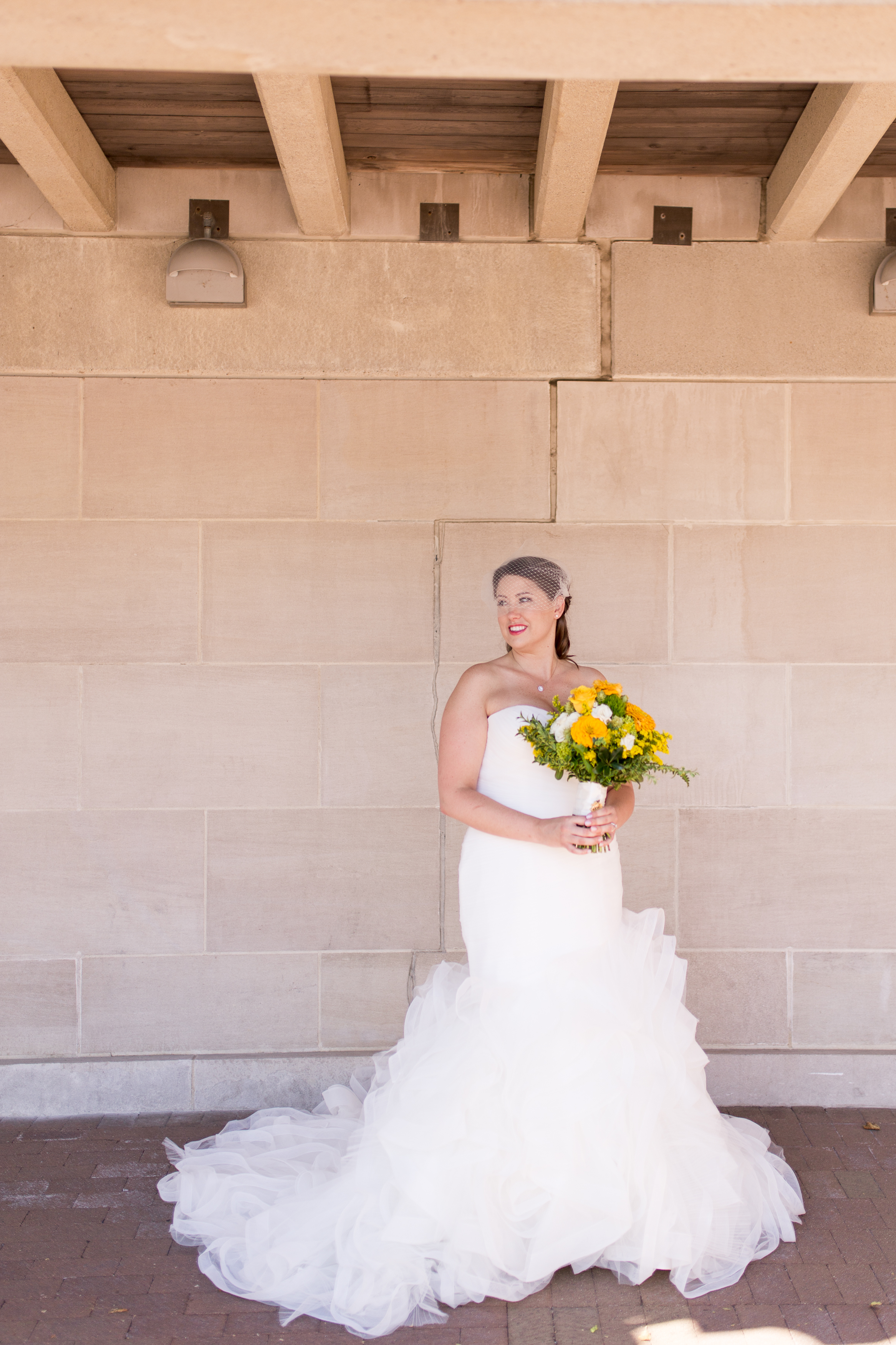 bride with bouquet outside Minnetrista in Muncie Indiana