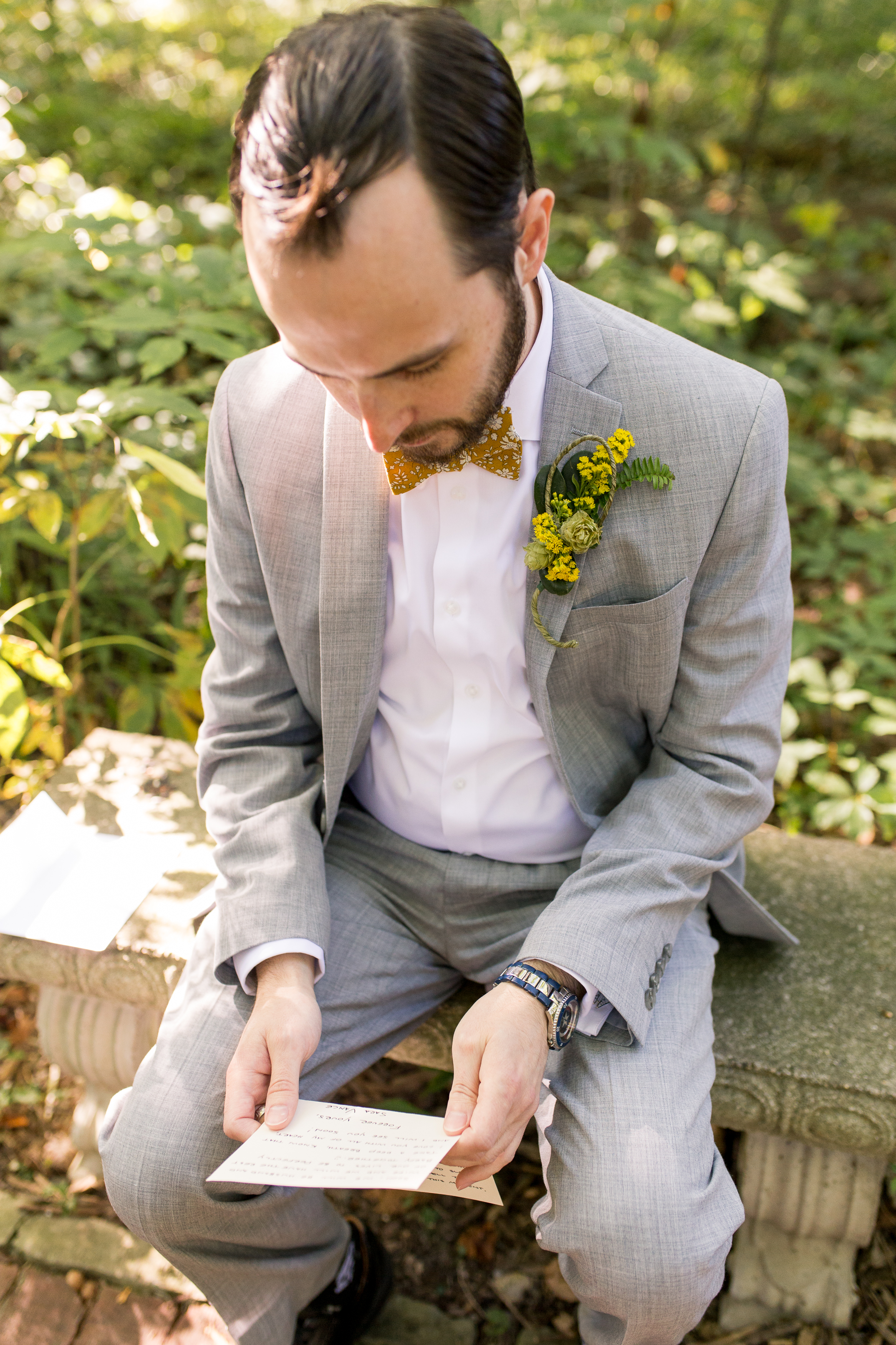 groom reading love letter from bride at Minnetrista