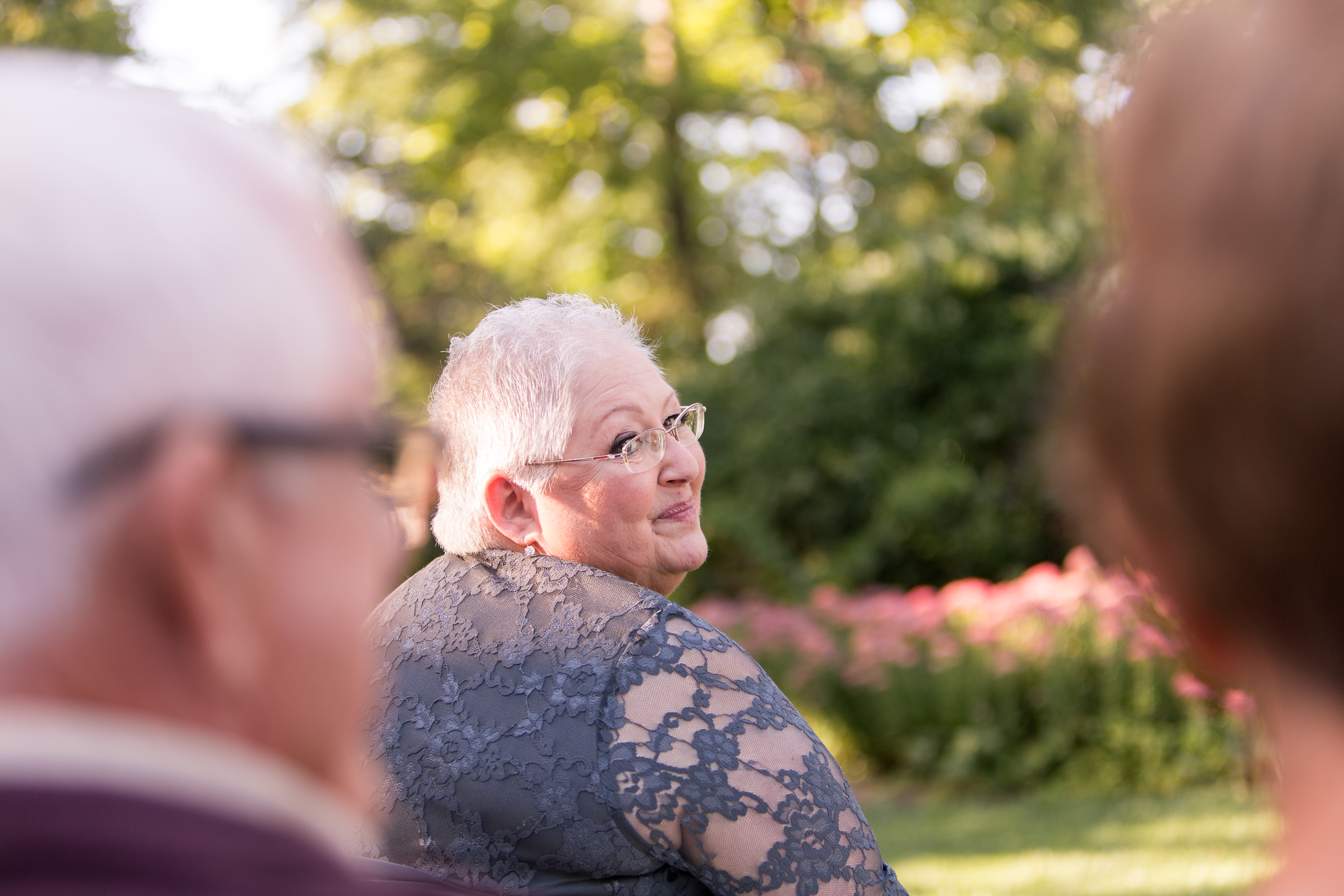 mother of bride watching bride walk down aisle at Minnetrista in Muncie Indiana