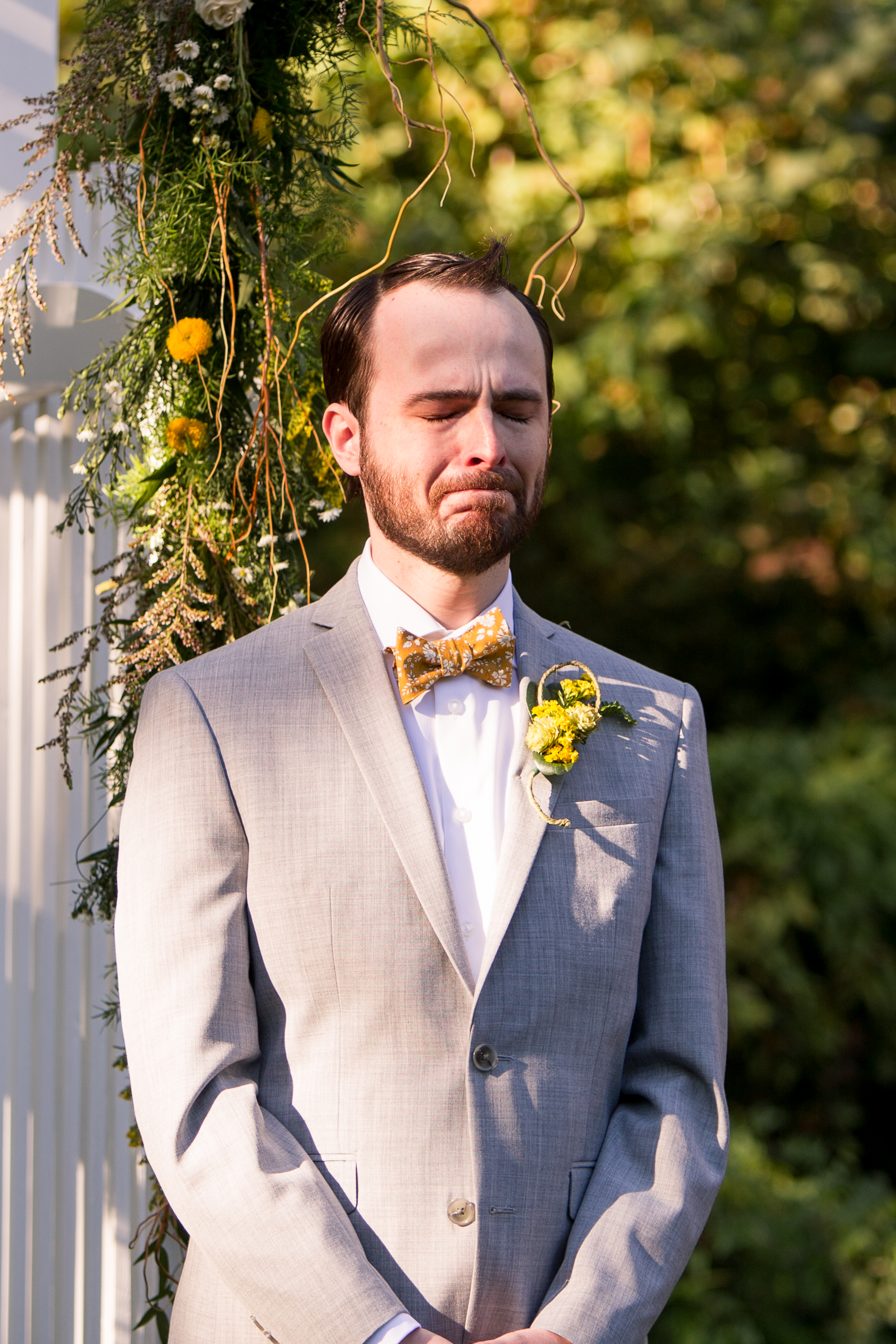 groom cries during wedding ceremony as bride comes down aisle at Minnetrista in Muncie Indiana