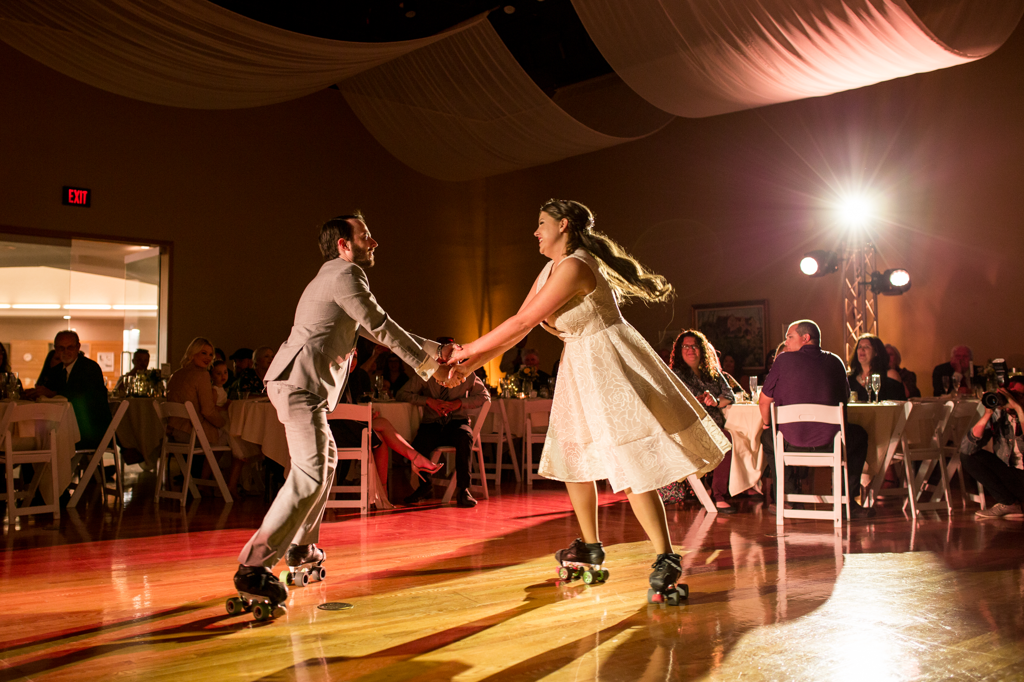 bride and groom first dance on rollerskates at Minnetrista in Muncie Indiana
