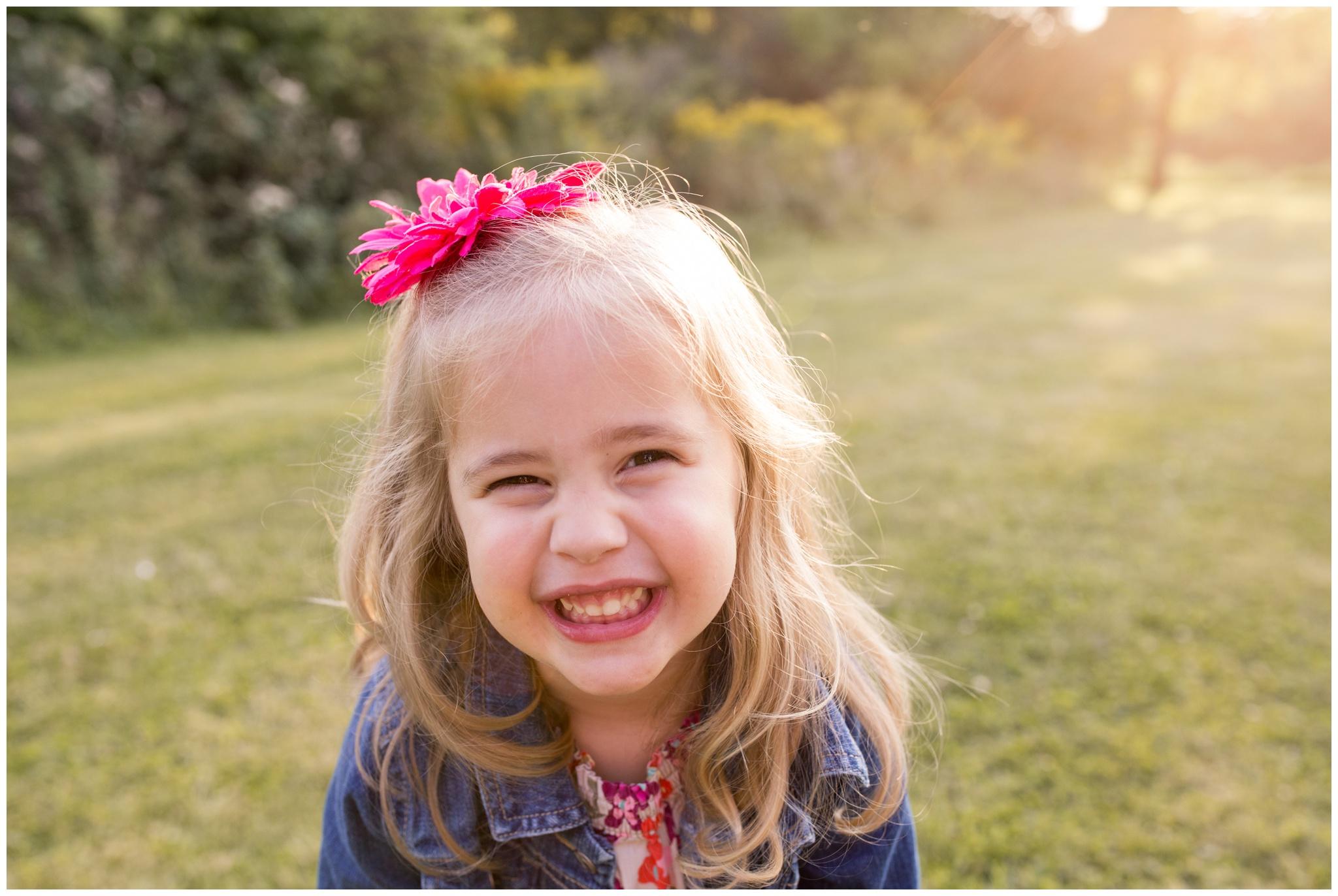 girl smiling at camera during family portraits at Wildcat Creek Reservoir Park in Kokomo Indiana