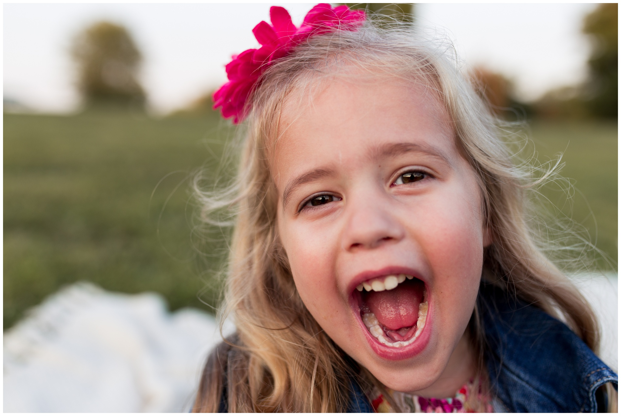 little girl in front of camera at Wildcat Creek Reservoir Park in Kokomo Indiana