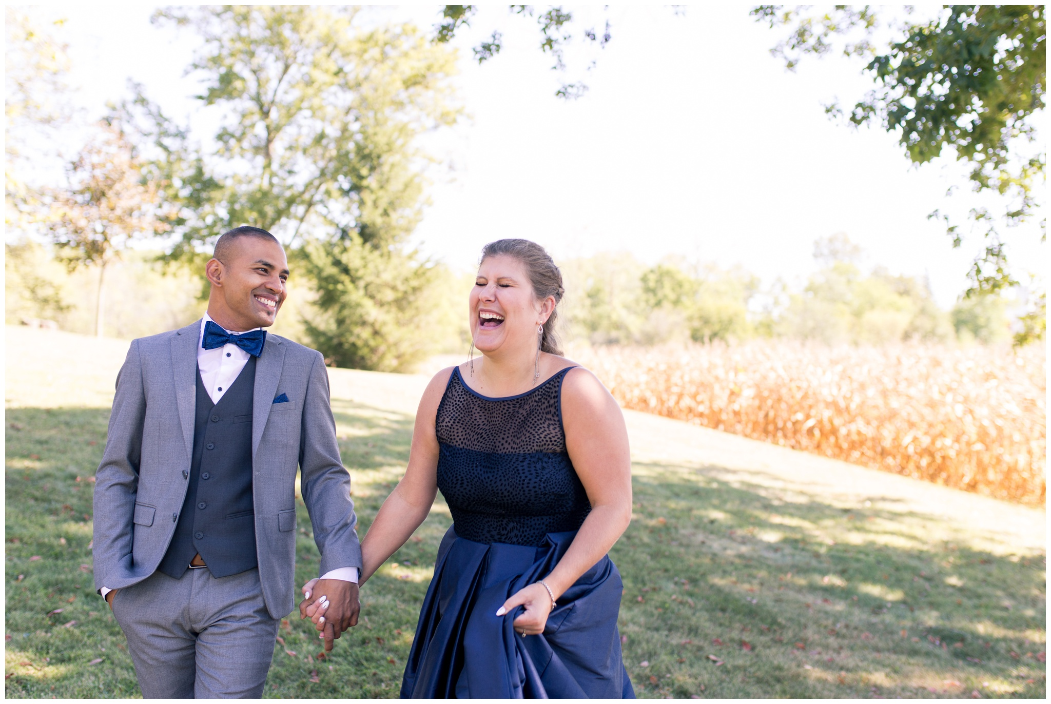 bride and groom laugh together during portraits before Romer's Catering Greenville wedding