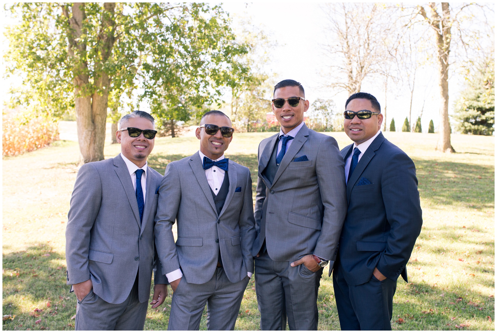 groom and groomsmen wearing sunglasses before wedding ceremony in Greenville Ohio