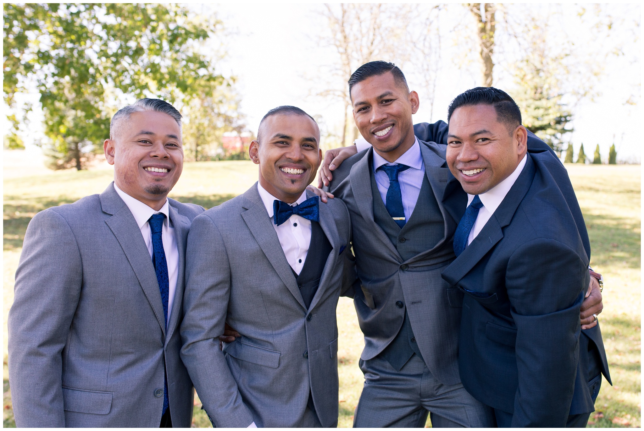 groom and groomsmen laughing together before wedding ceremony in Greenville Ohio
