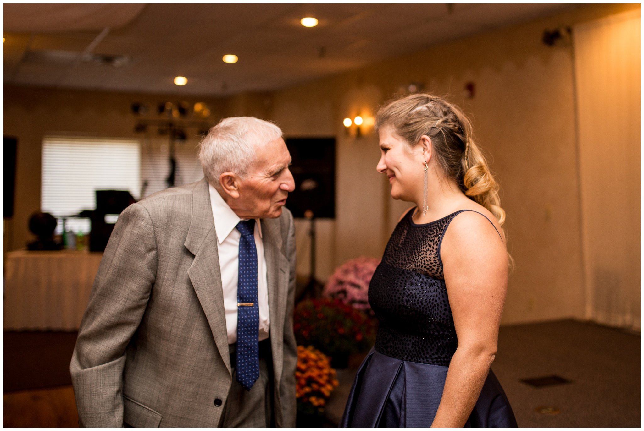 bride talking with grandfather before wedding ceremony at Romer's Catering in Greenville Ohio