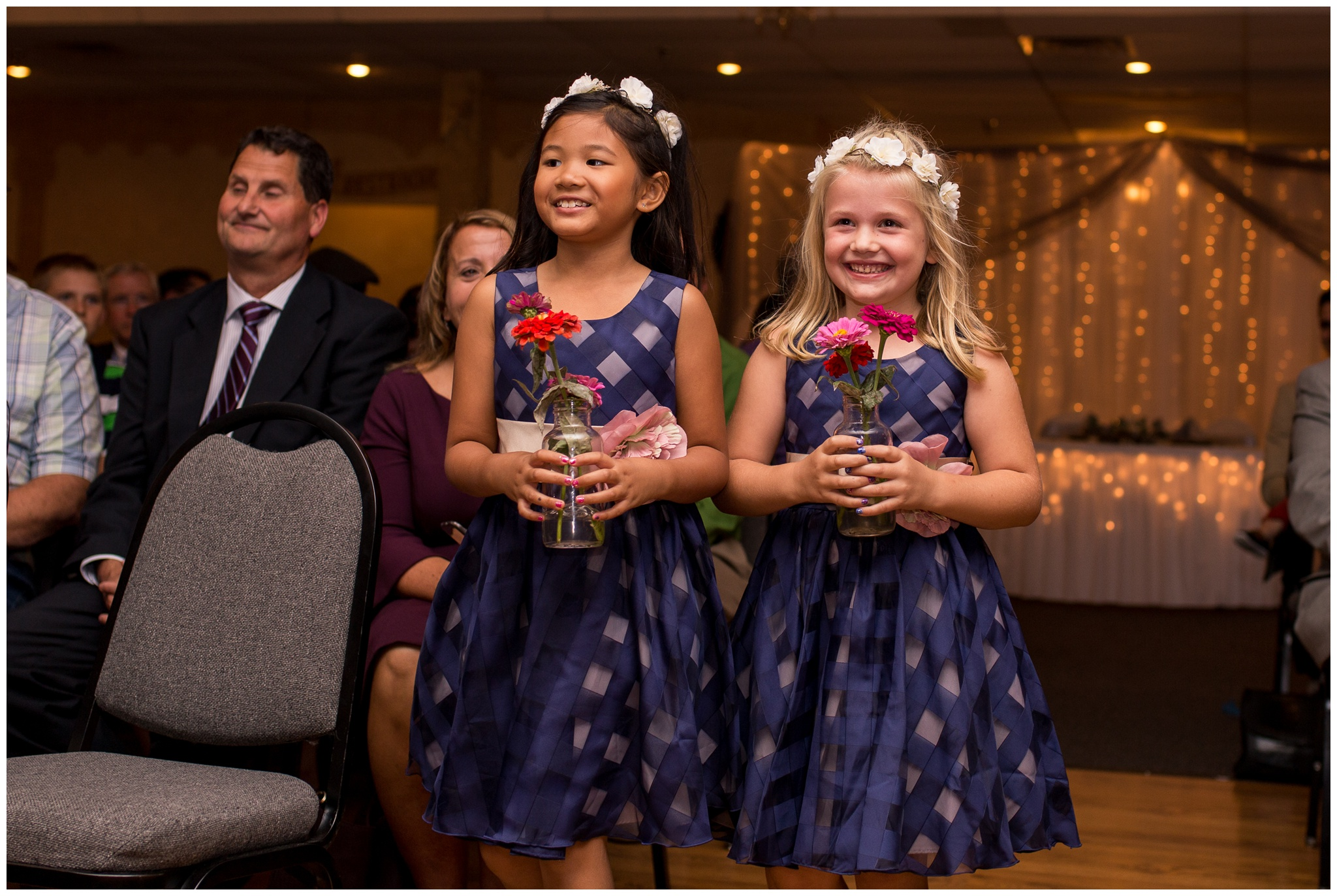 flower girls entering wedding ceremony at Romer's Catering in Greenville Ohio