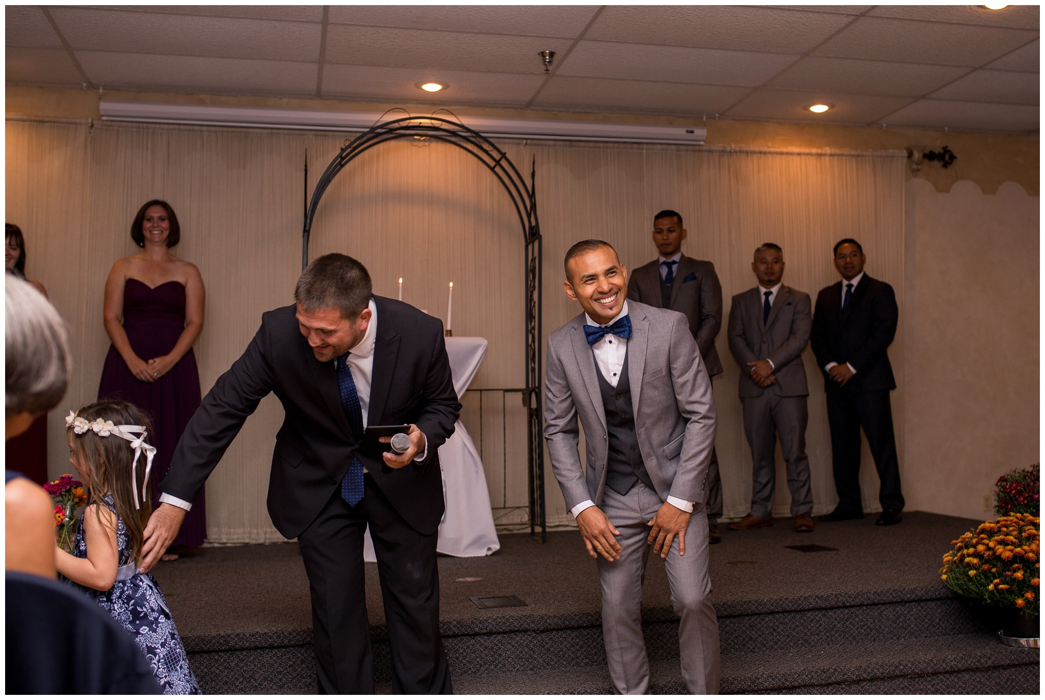 groom laughing during wedding ceremony at Romer's Catering in Greenville Ohio