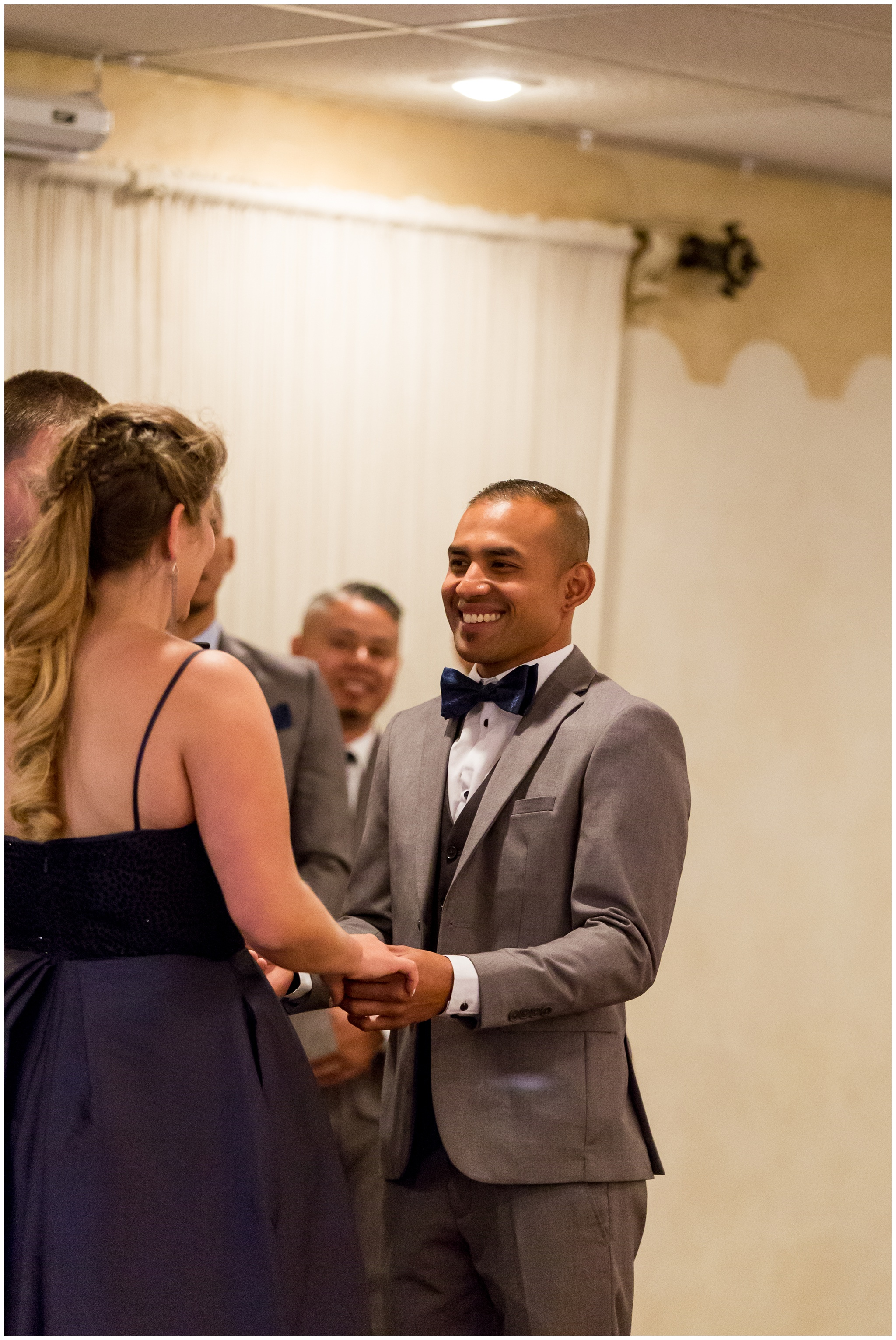 groom smiling at bride during wedding ceremony at Romer's Catering in Greenville Ohio