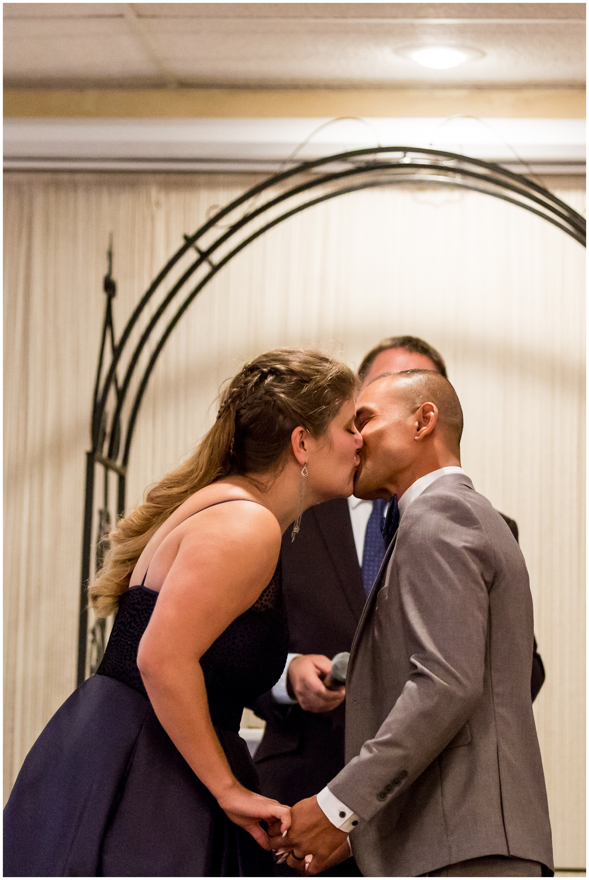 bride and groom's first kiss during Romer's Catering Greenville wedding