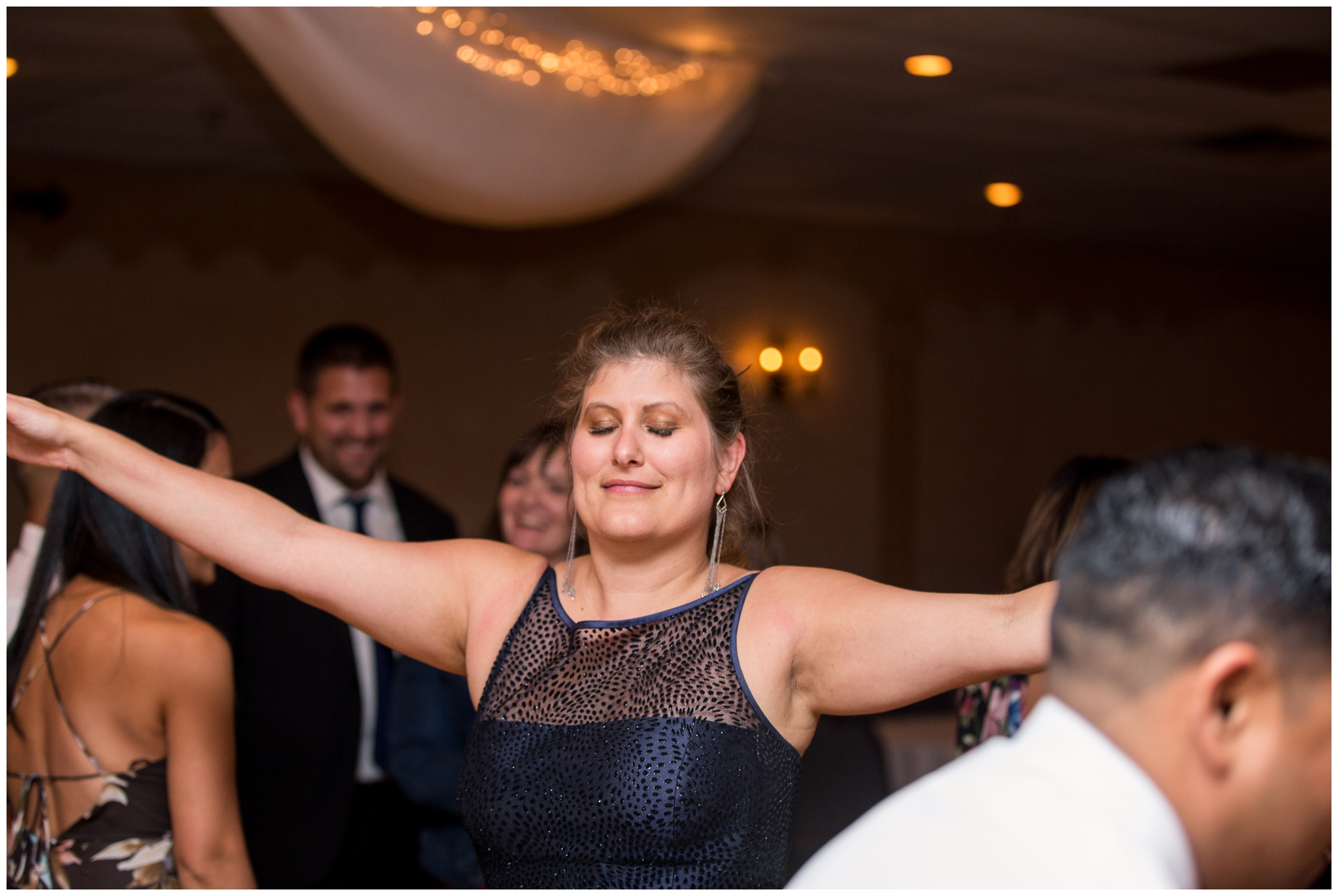 bride dances during reception at Romer's Catering in Greenville Ohio