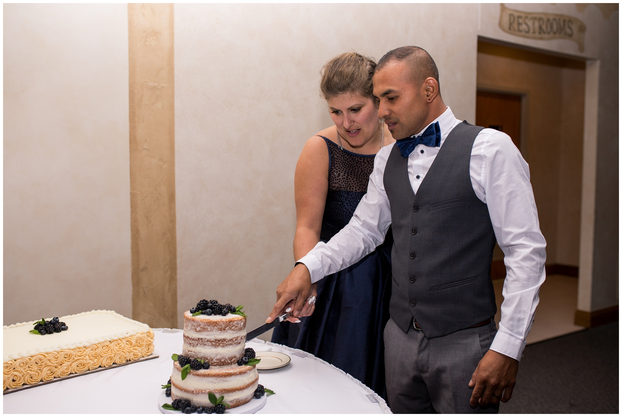 bride and groom cut wedding cake at Romer's Catering in Greenville Ohio