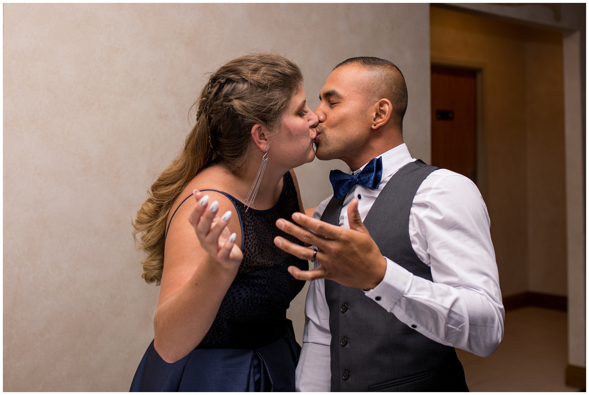 bride and groom kiss after cake cutting during Romer's Catering Greenville wedding reception