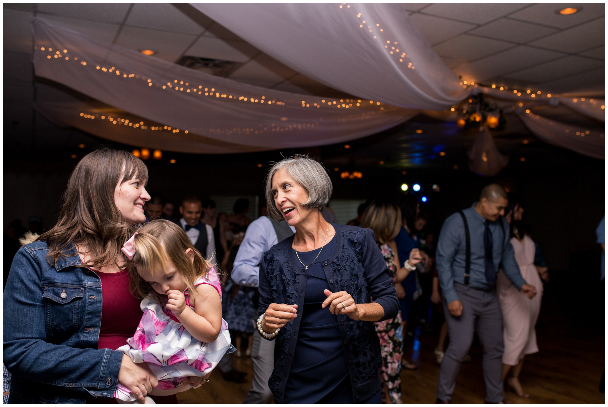 mother of bride dances during wedding reception at Romer's Catering in Greenville Ohio