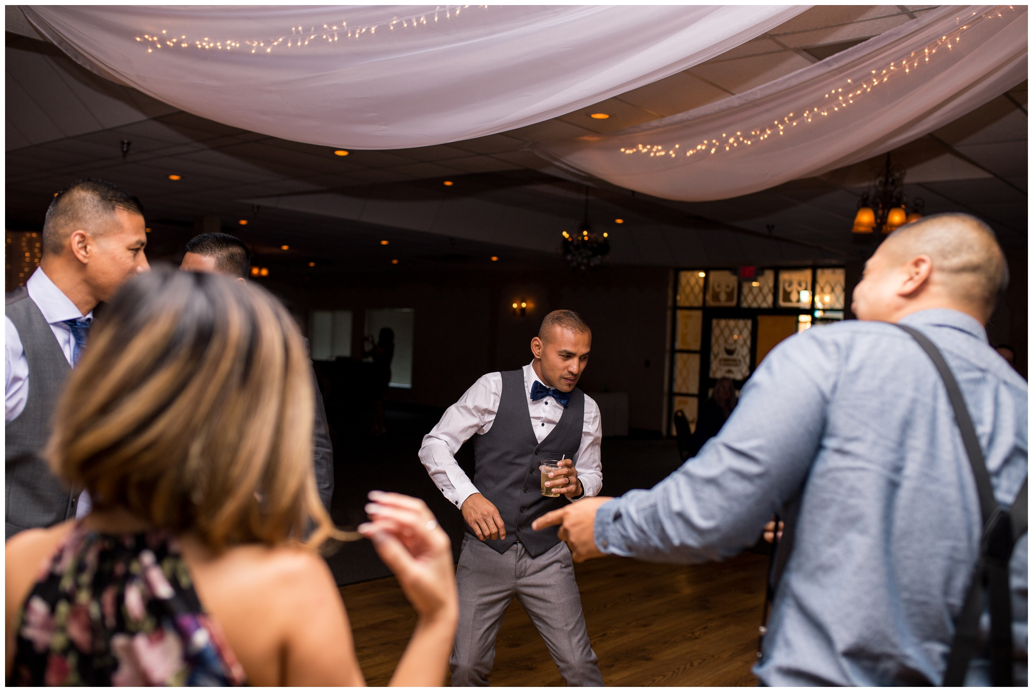 groom dancing during wedding reception at Romer's Catering in Greenville Ohio