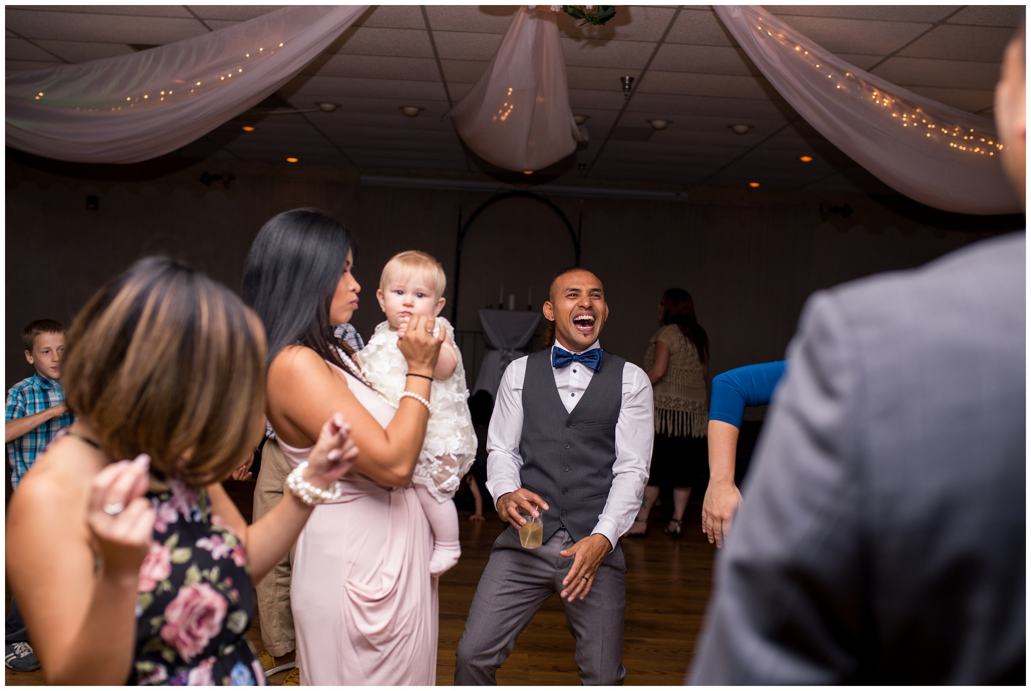 groom dancing with family during wedding reception at Romer's Catering in Greenville Ohio