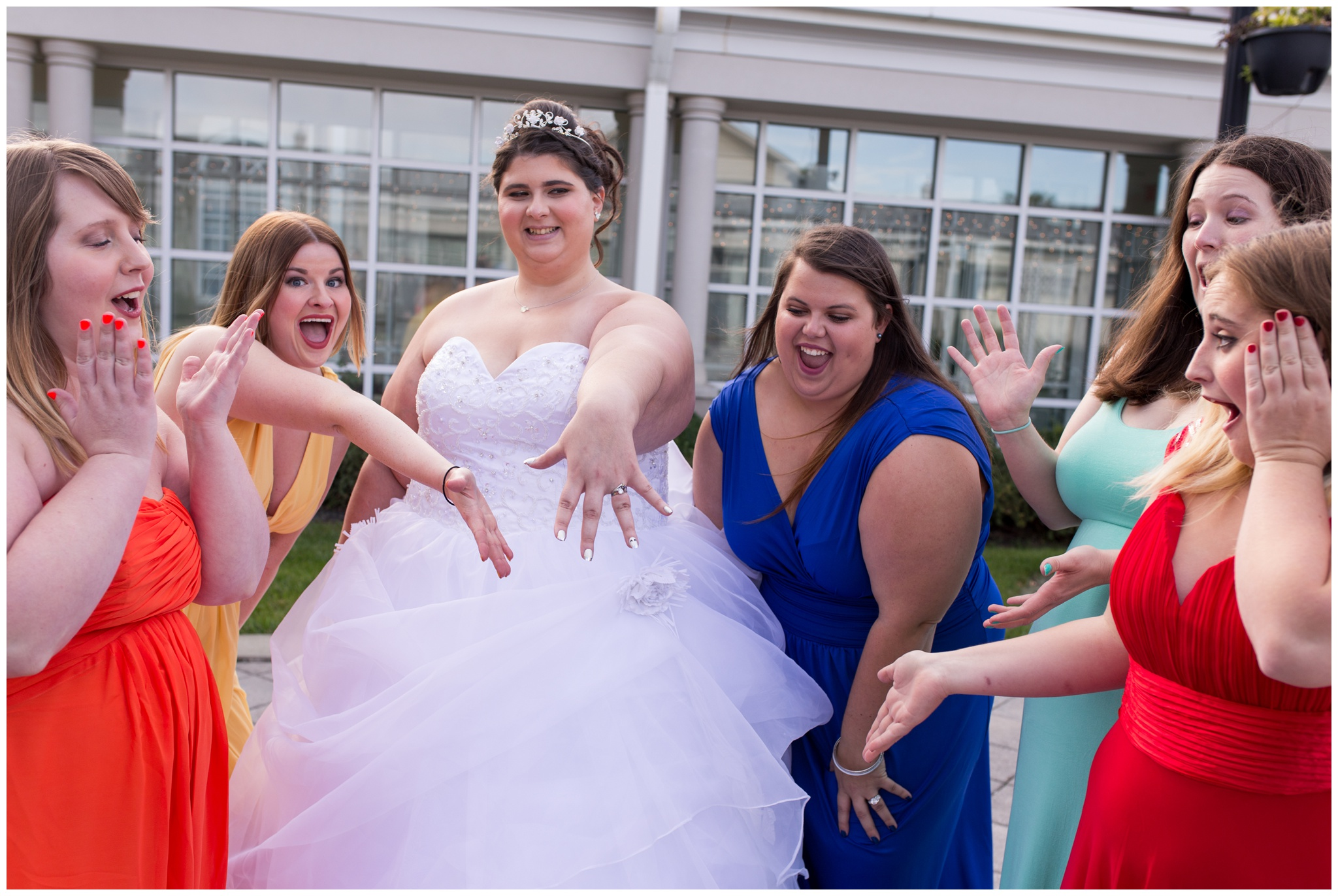 bridesmaids reacting to bride's ring at Community Life Center in Indianapolis Indiana