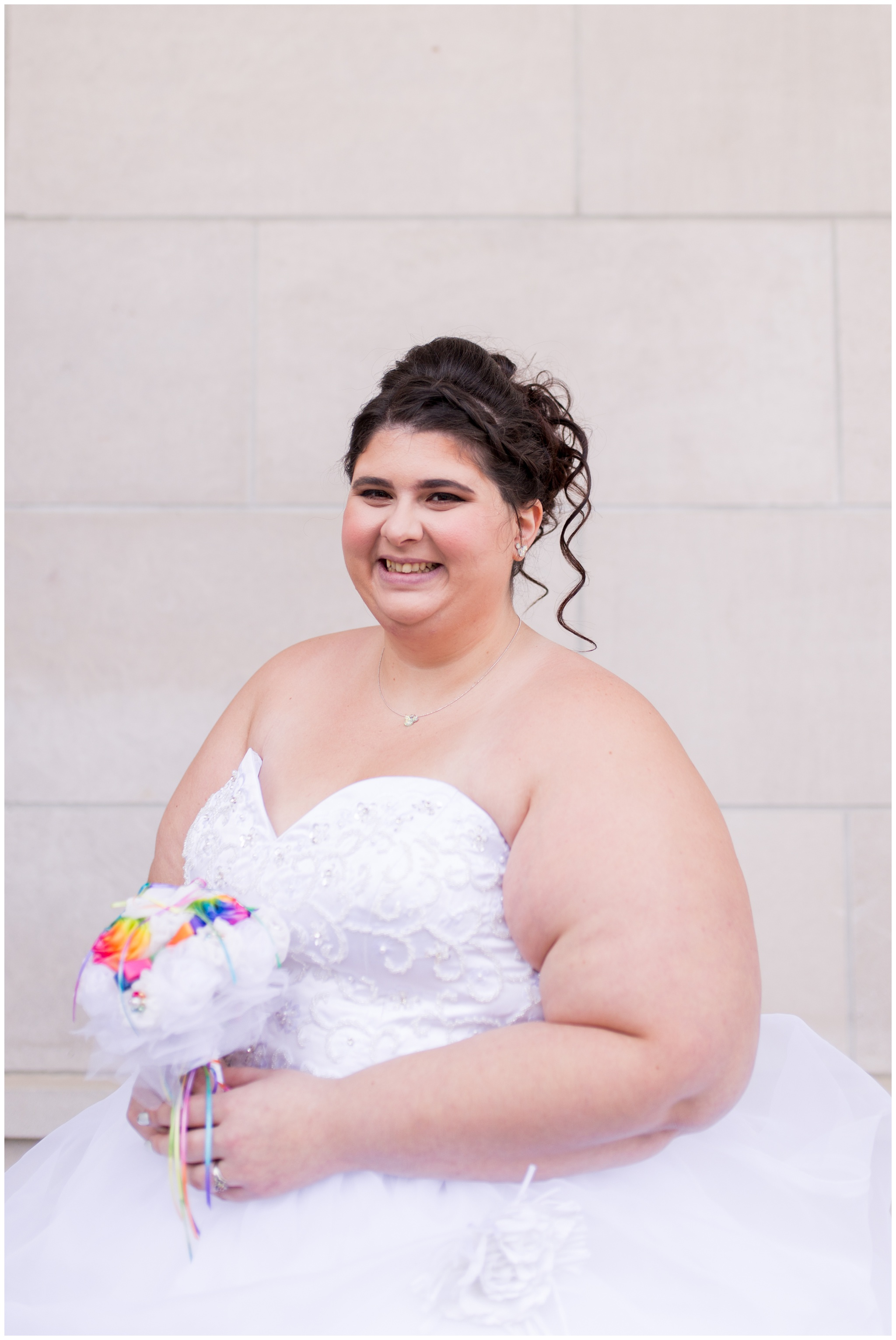 bride with bouquet outside Community Life Center in Indianapolis Indiana