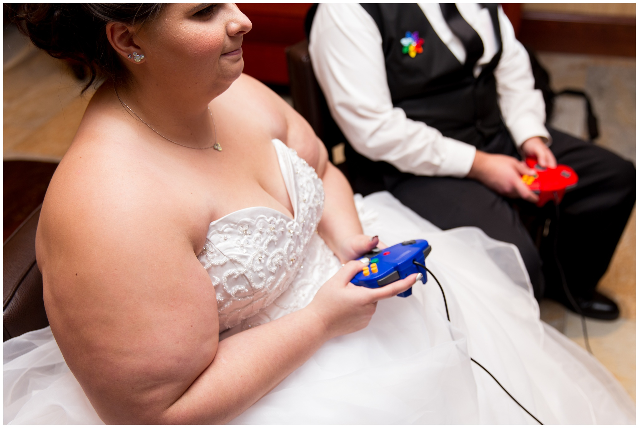 bride and groom playing GameCube at Community Life Center in Indianapolis Indiana