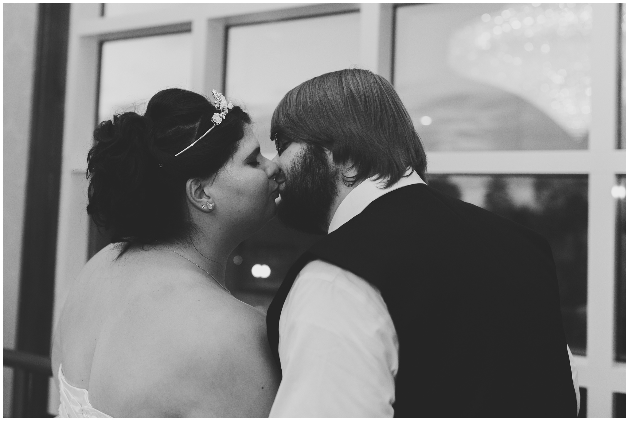 bride and groom kissing in crystal tower at Community Life Center in Indianapolis Indiana
