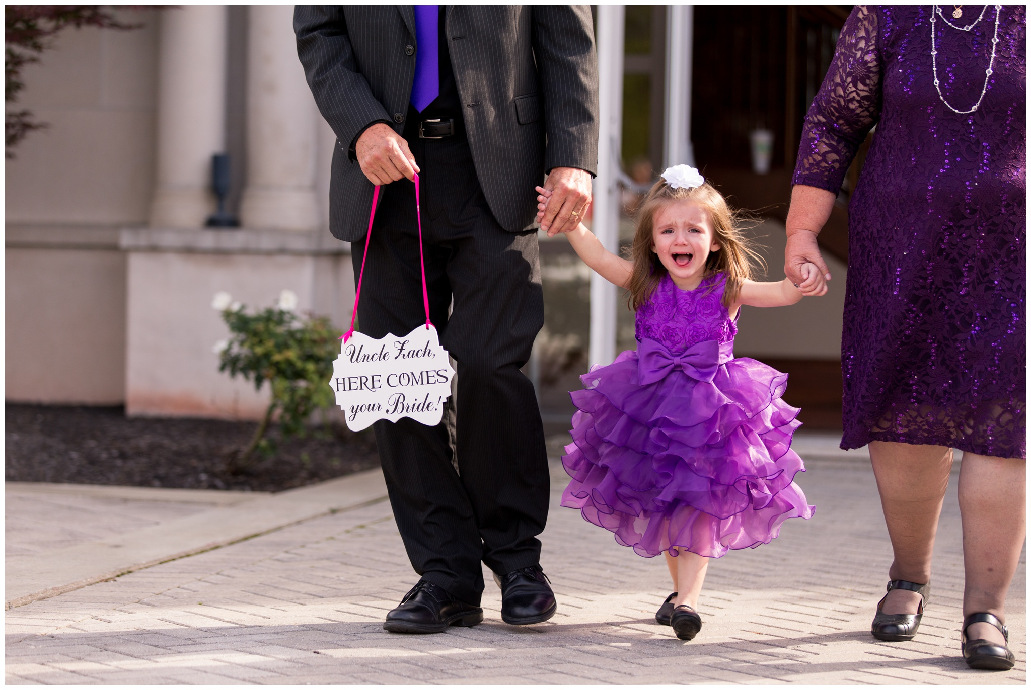 flower girl walking down aisle during wedding at Community Life Center in Indianapolis Indiana
