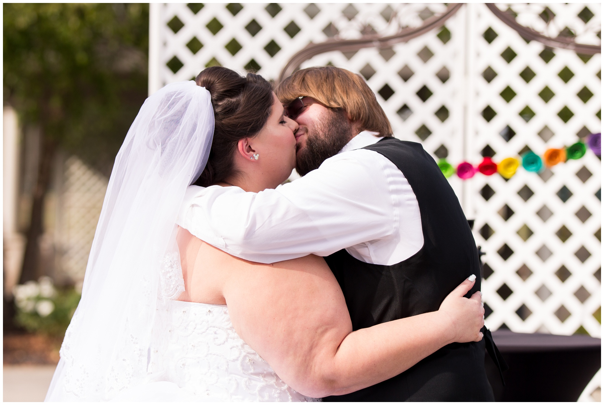 bride and groom first kiss at Community Life Center wedding in Indianapolis Indiana