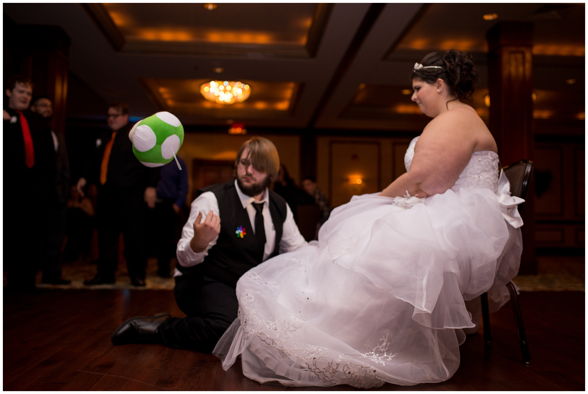 groom finding garter during Community Life Center wedding reception in Indianapolis