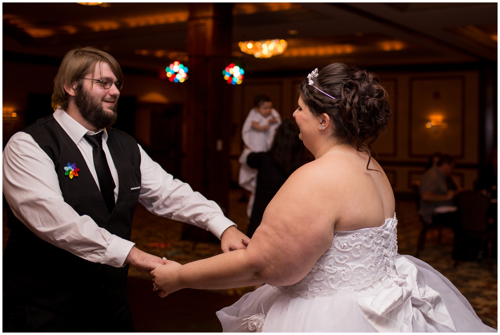 bride and groom dancing during wedding reception at Community Life Center in Indianapolis