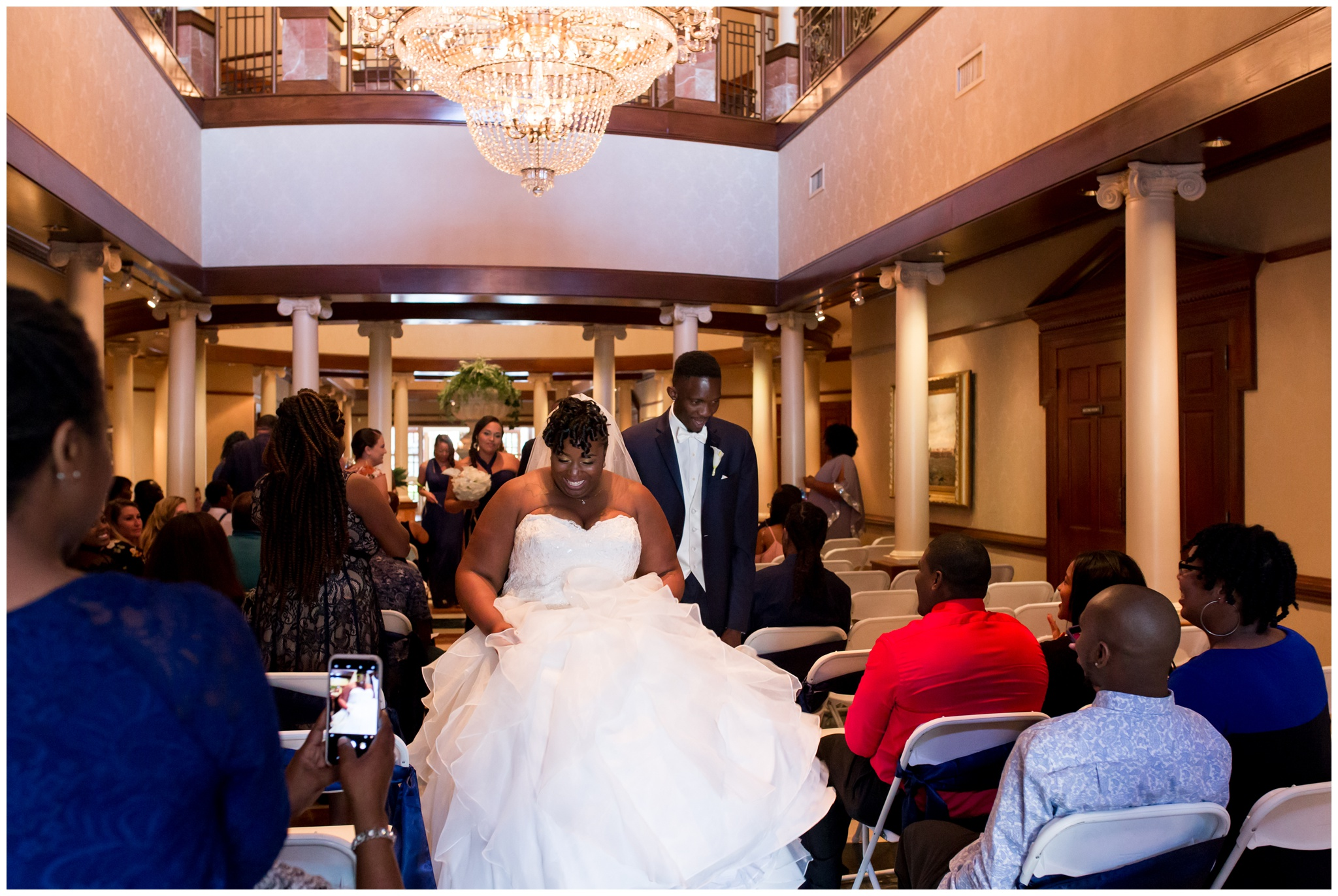 bride and groom exiting ceremony at Community Life Center Indianapolis