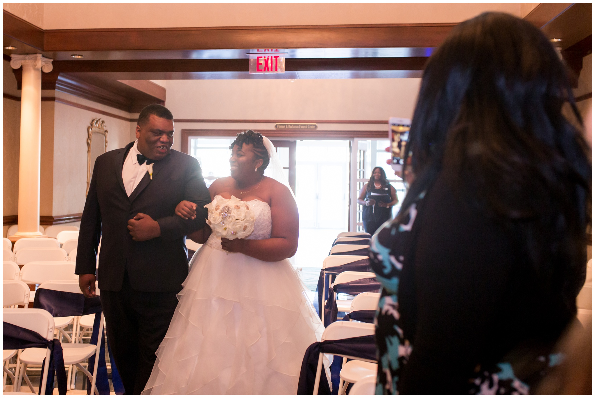 bride and brother walking down aisle at Community Life Center Indianapolis