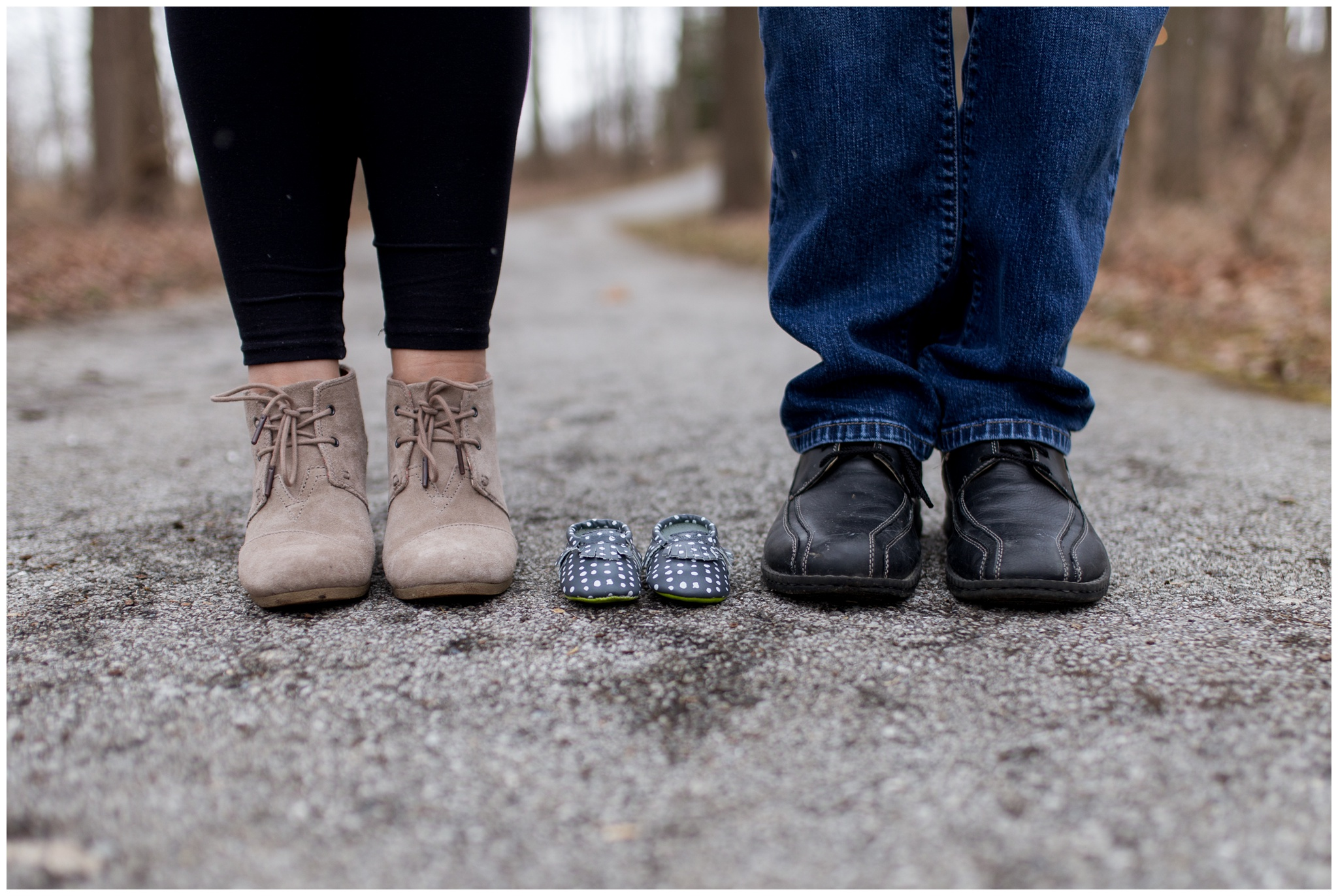 mom and dad's shoes next to baby shoes during Kokomo Indiana maternity session at Jackson Morrow Park