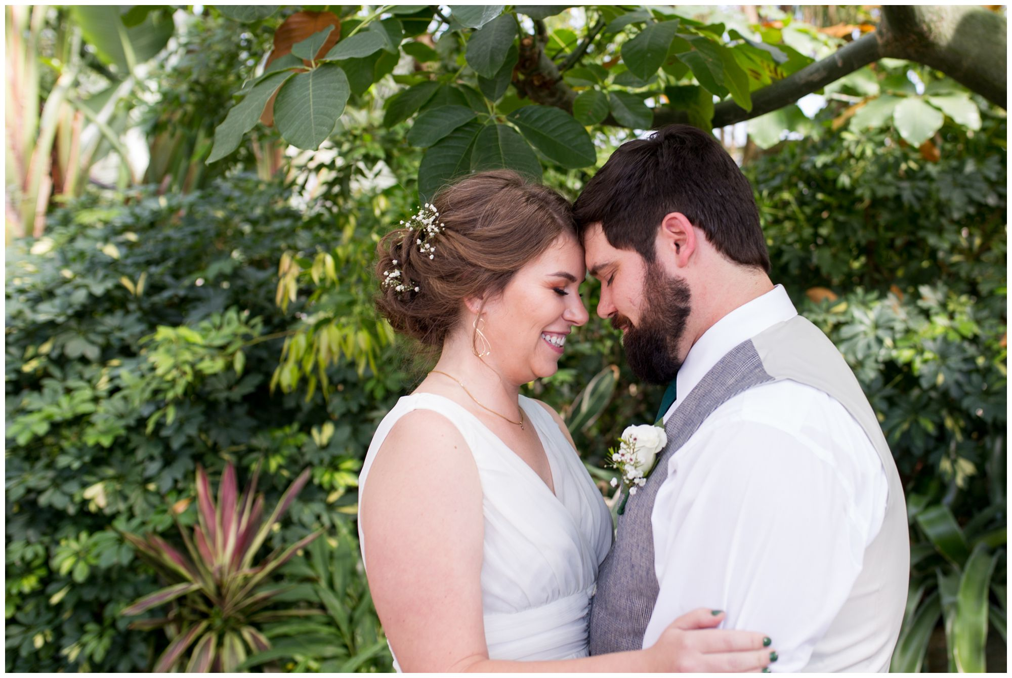 bride and groom portraits in Garfield Park Conservatory Indianapolis elopement