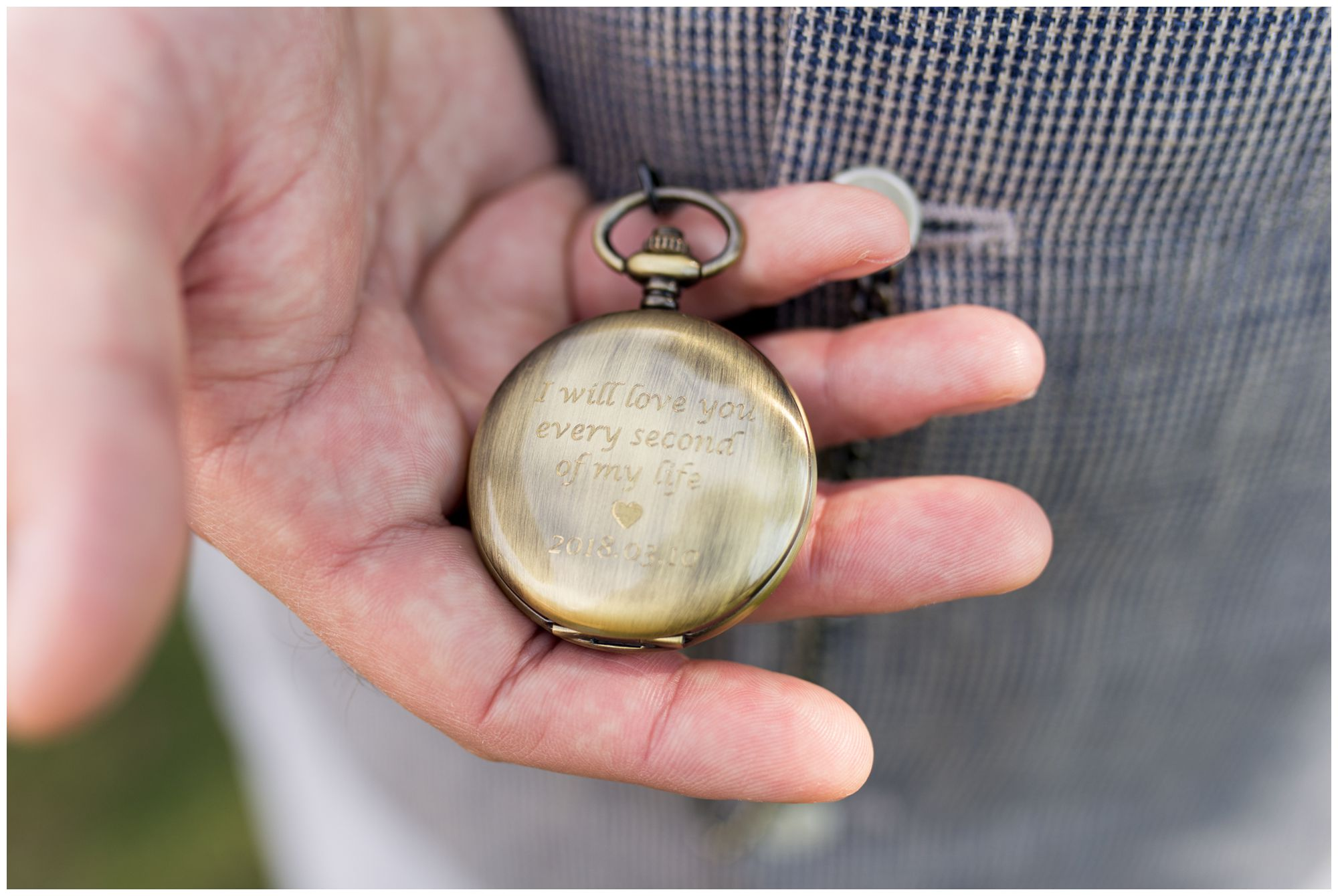groom holding pocket watch before wedding at Garfield Park Conservatory in Indianapolis