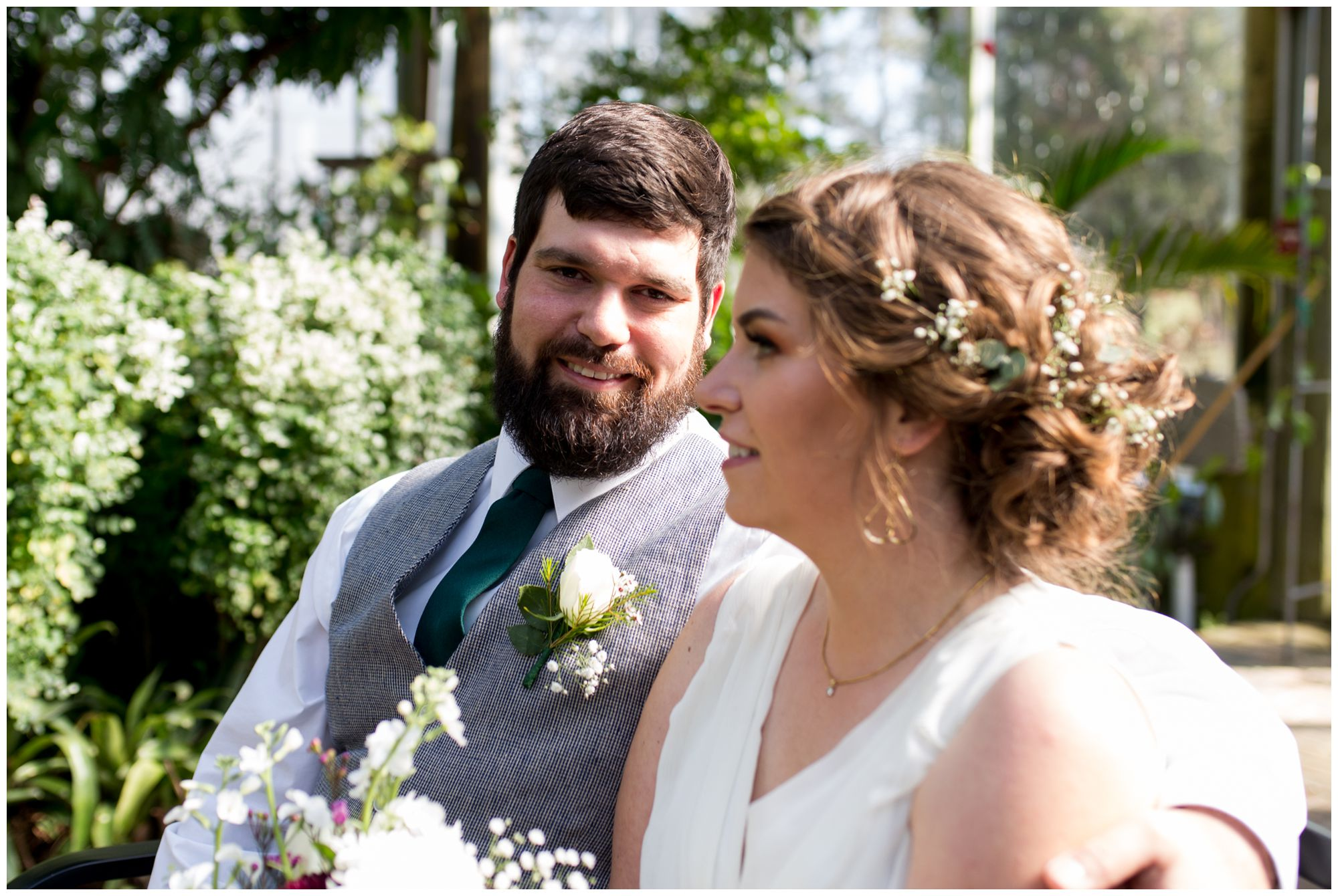 groom with bride before wedding at Garfield Park Conservatory in Indianapolis